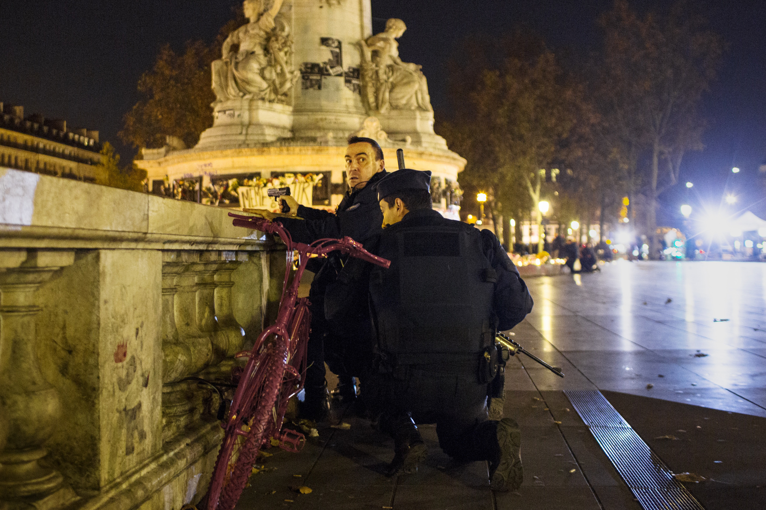 Armed police take aim in Paris' Place de la République during a false alarm on Nov.15