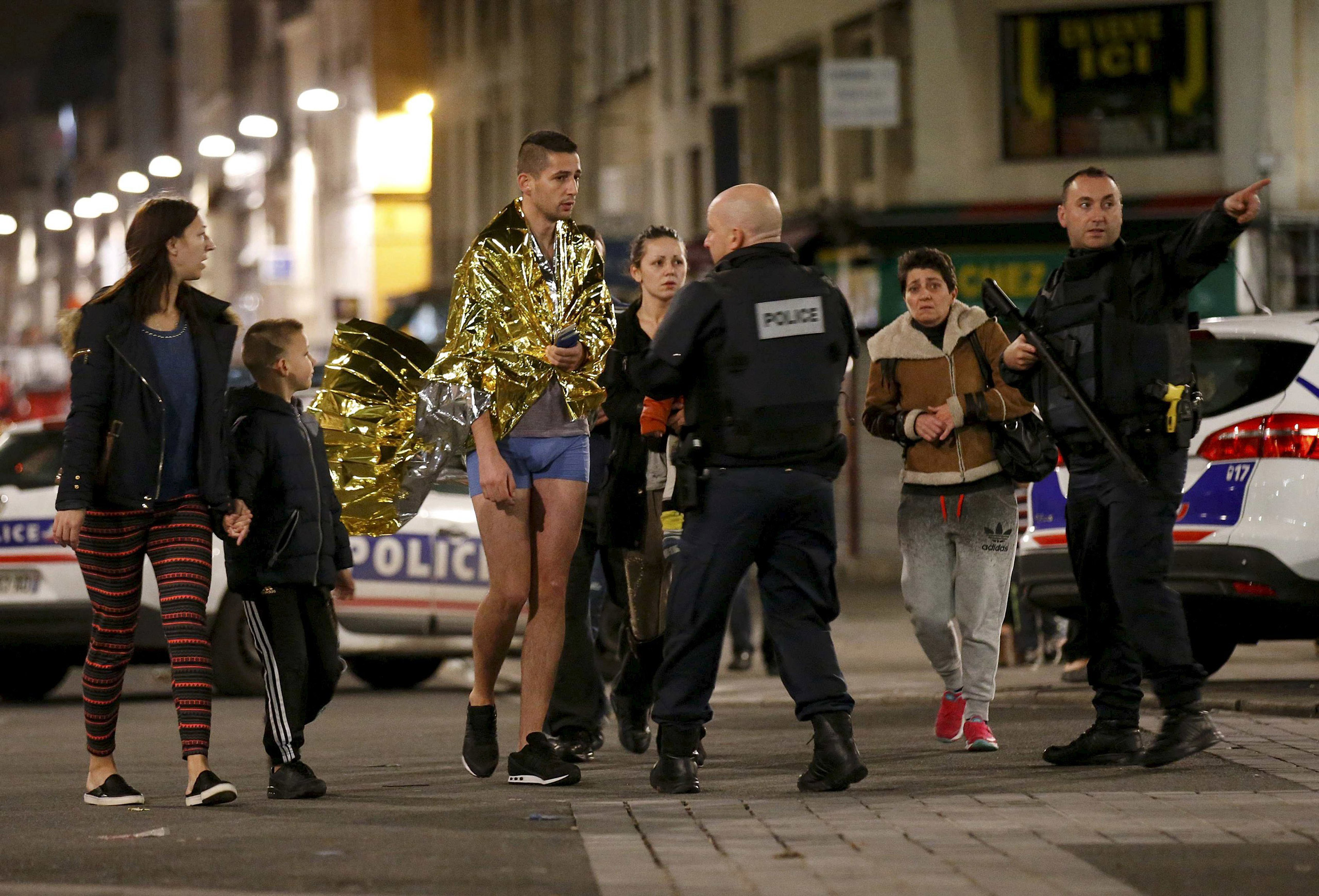 French police evacuate residents during an operation to catch fugitives from Friday night's deadly attacks in Saint-Denis, outside of Paris, on Nov. 18, 2015.