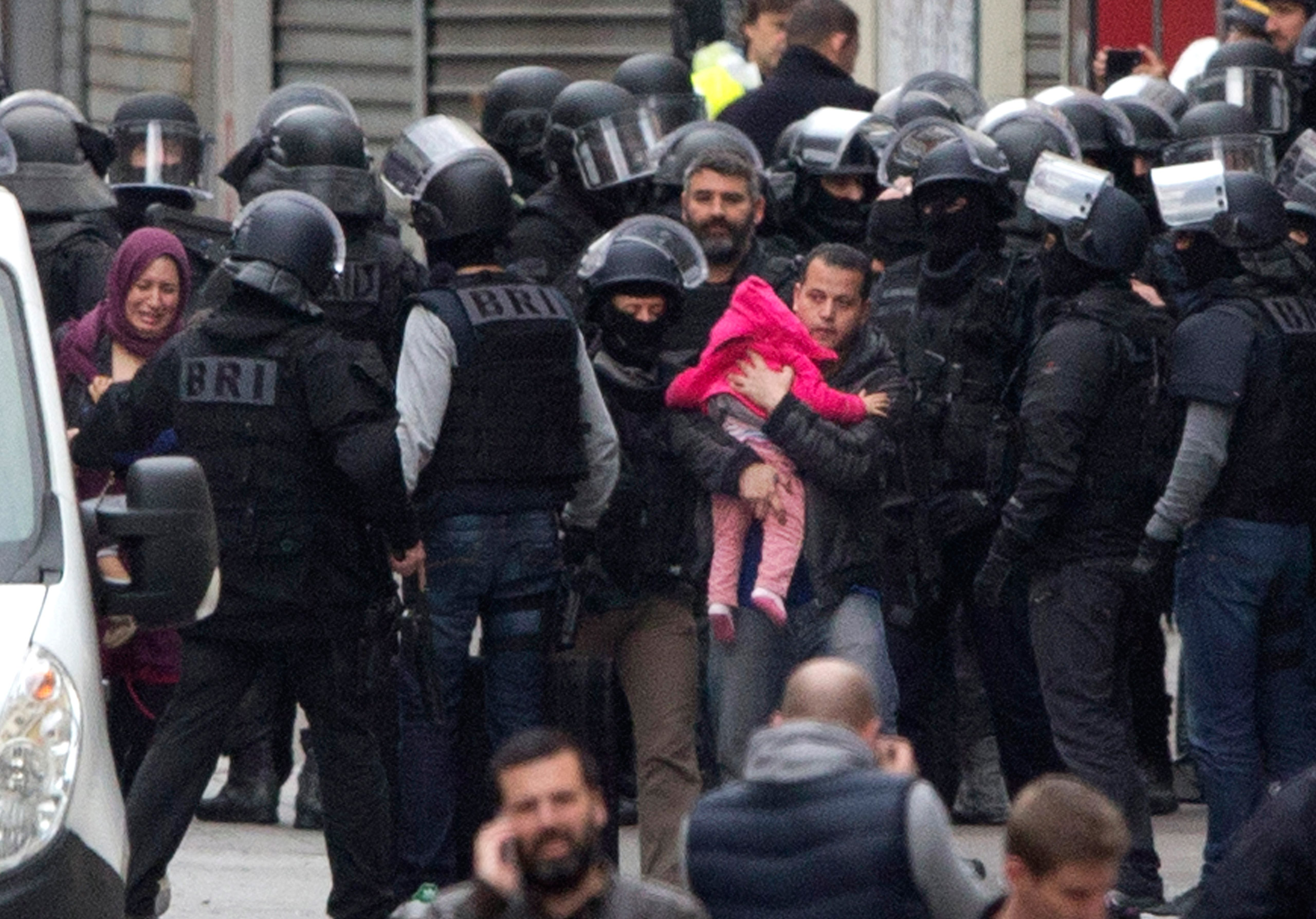 Residents are evacuated after a woman wearing an explosive suicide vest blew herself up as heavily armed police tried to storm an apartment during an anti-terrorism raid in Saint Denis, outside of Paris, on Nov. 18, 2015.