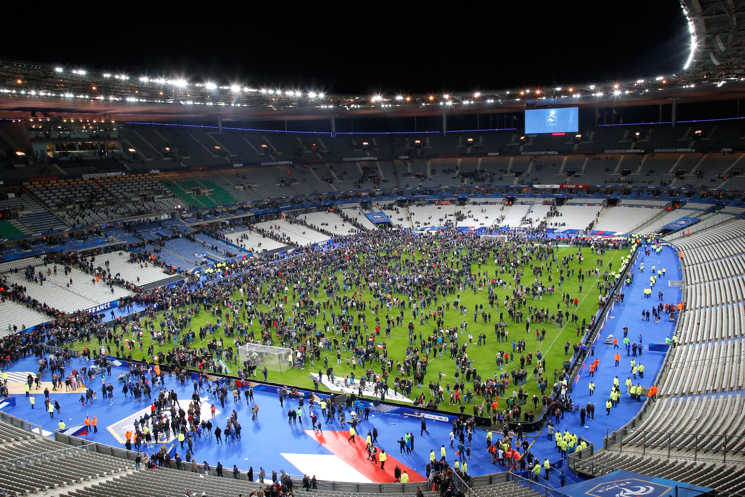 Spectators invade the pitch of the Stade de France stadium after the international friendly soccer France against Germany in Saint Denis, outside Paris on Nov. 13, 2015.