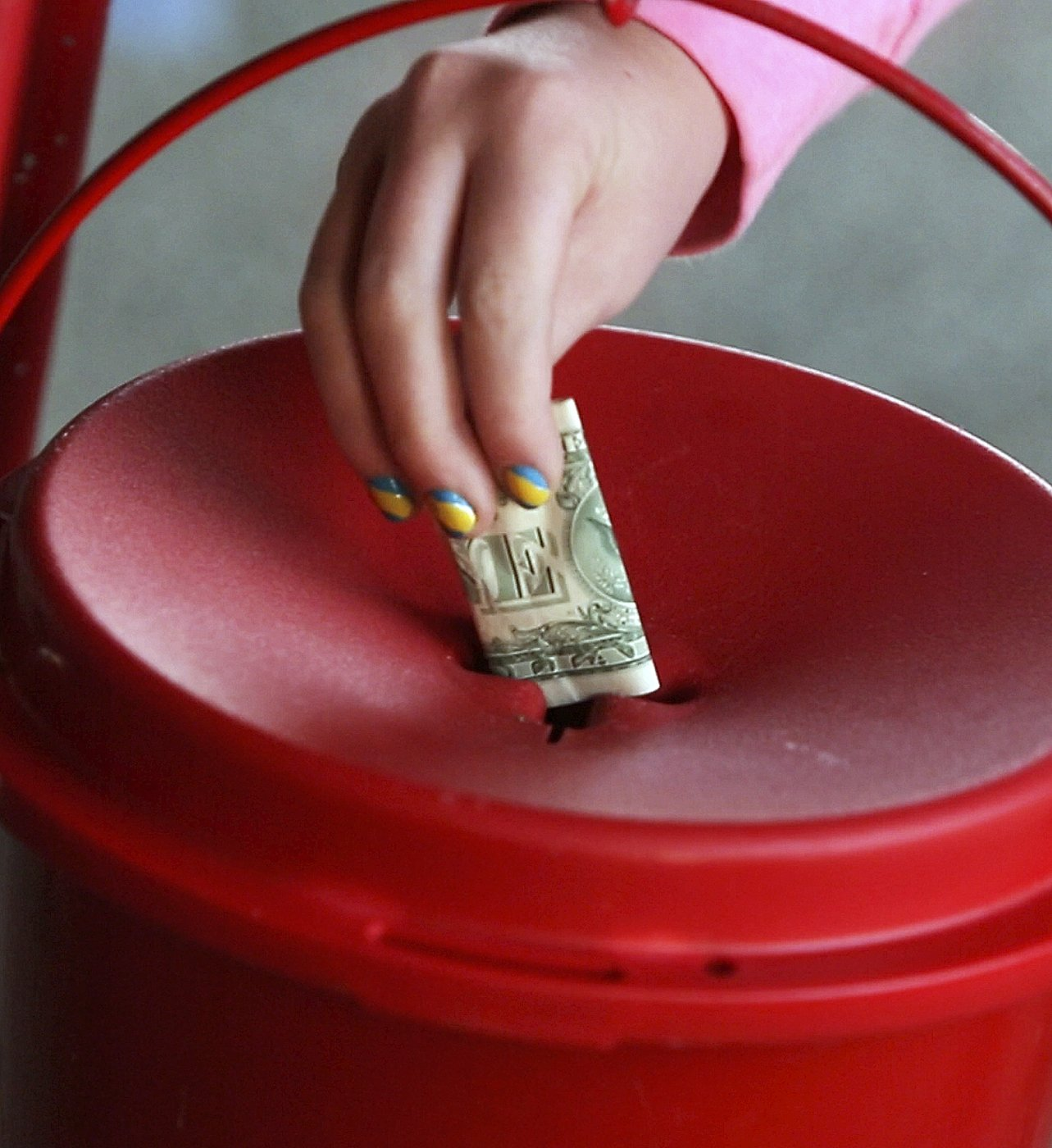 A donation is made to the Salvation Army kettle.