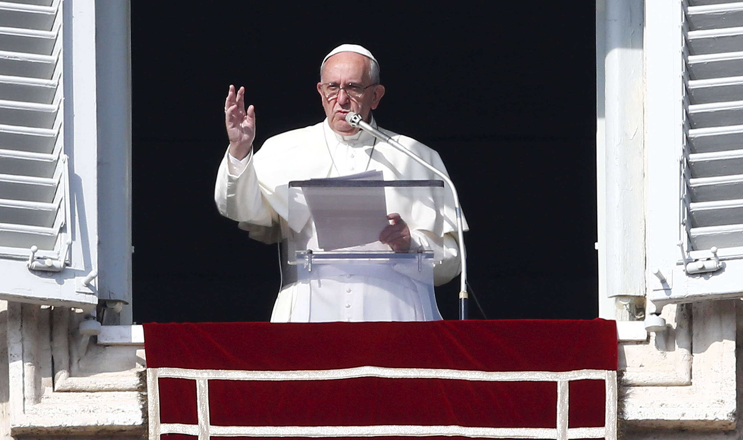 Pope Francis gestures during his Sunday Angelus prayer in Saint Peter's square at the Vatican, on Nov. 15, 2015.