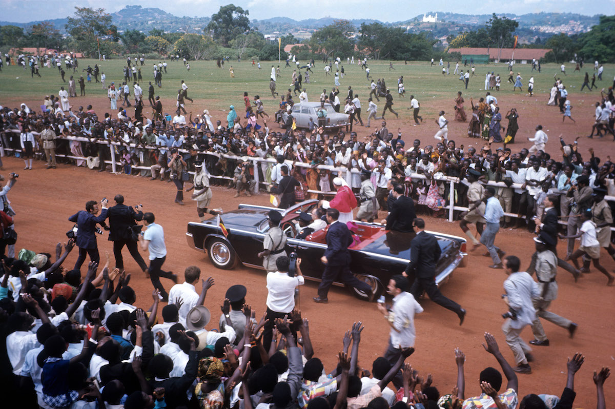 Pope Paul VI greeting people while in the outskirts of Kampala, the capital city of Uganda. Aug. 1, 1969.