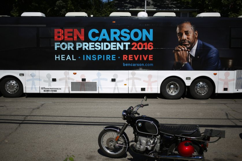 A campaign bus bearing the likeness of presidential candidate Ben Carson is parked near a campaign stop in Jackson, Mich. on Sept. 23, 2015.