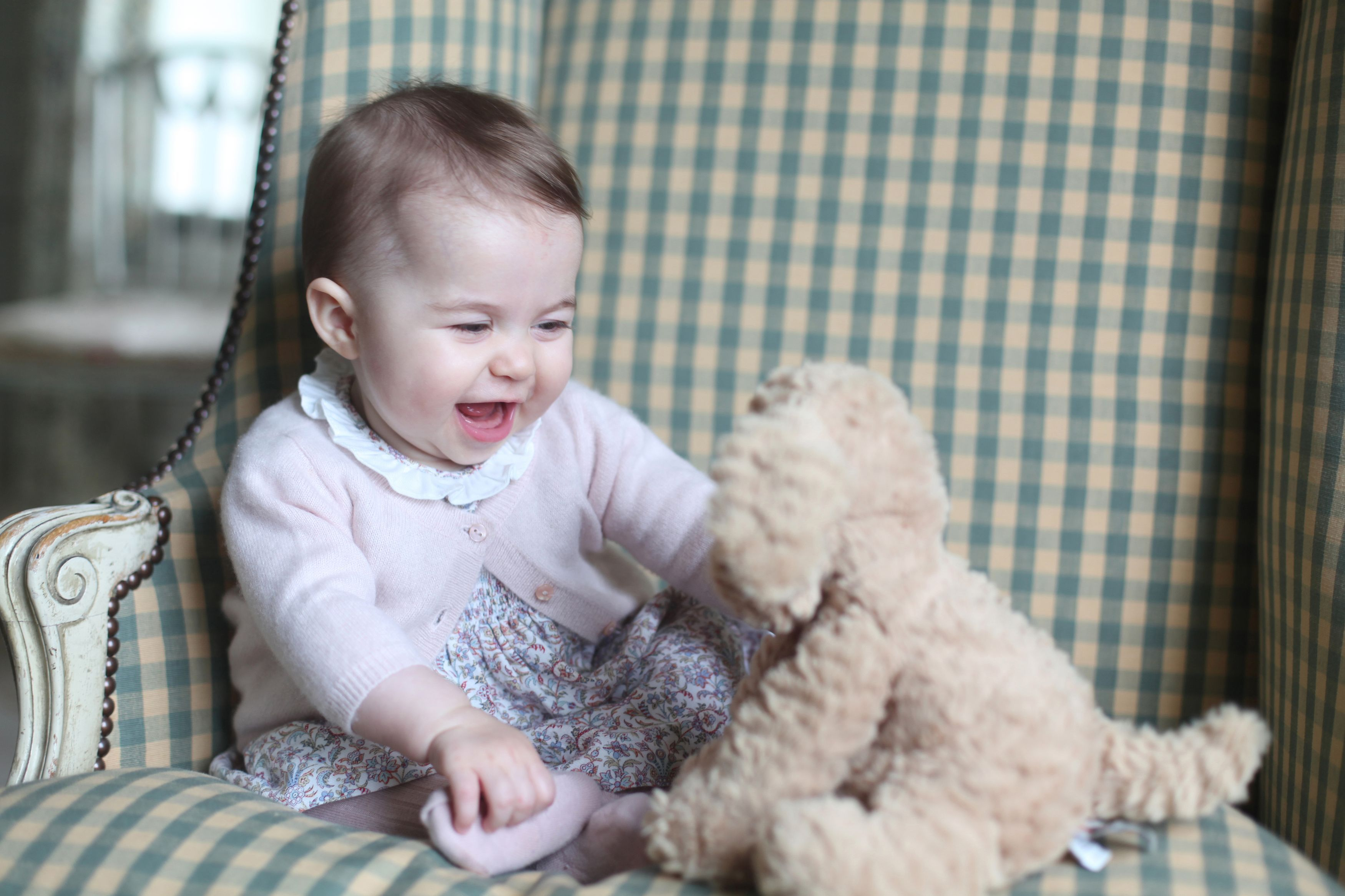 Princess Charlotte with her cuddly toy dog at Anmer Hall in Sandringham, UK in Nov. 2015.