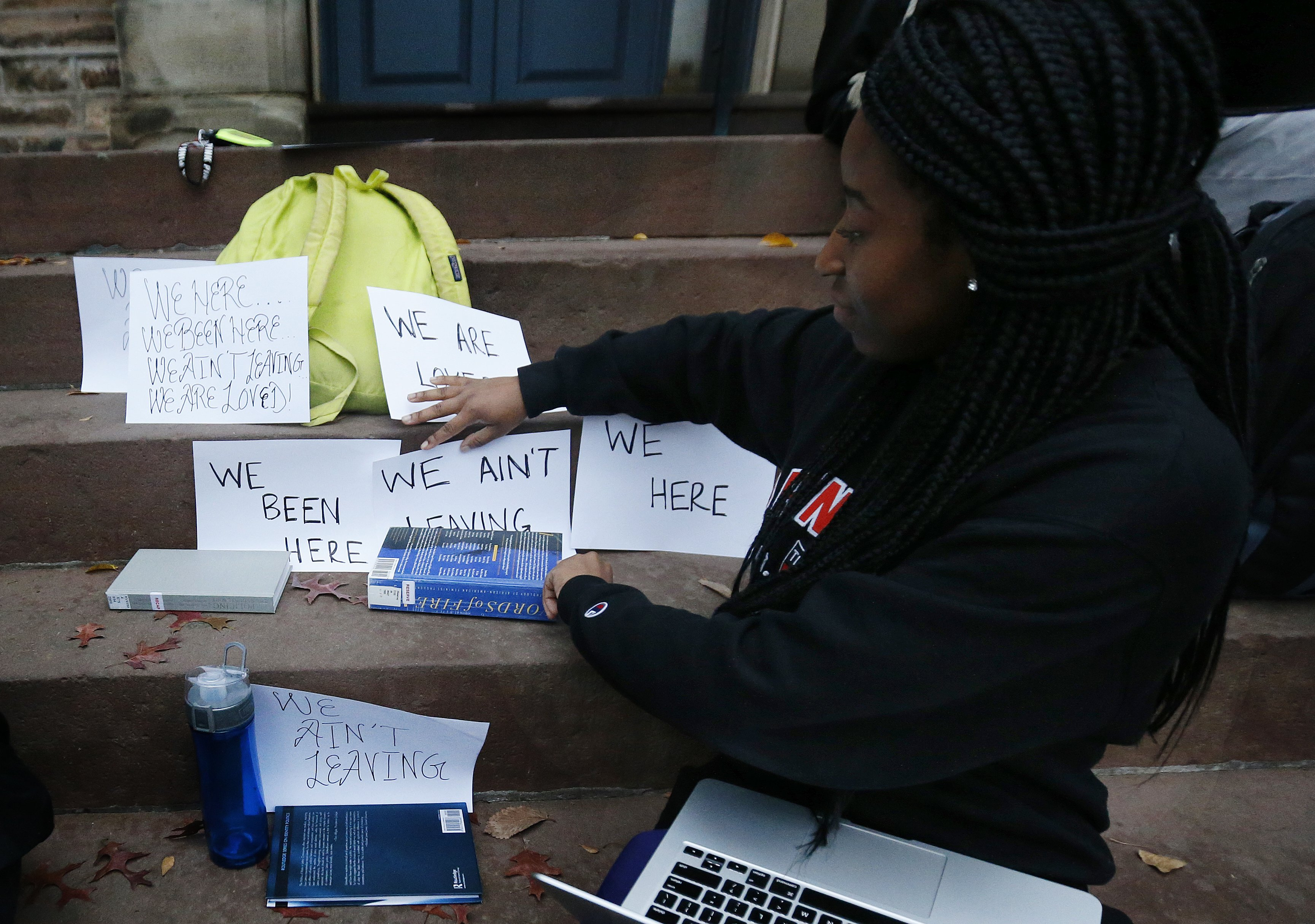 A student shows signs made for a sit-in to demand changes to improve the social and academic experience of black students, at Princeton University in Princeton, N.J. on Nov. 18, 2015.