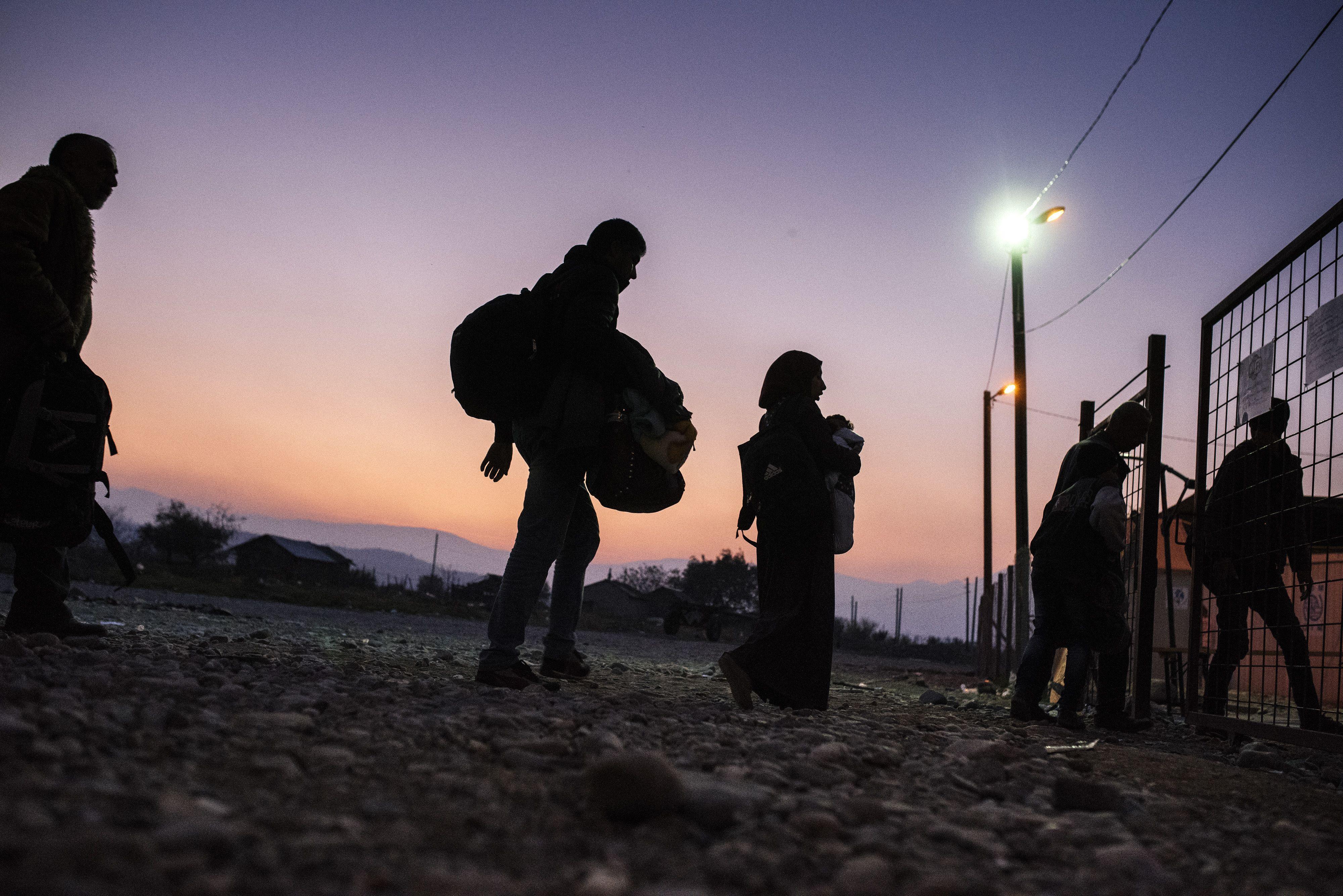 Migrants and refugees enter a registration camp after crossing the Greek-Macedonian border near Gevgelija, Macedonia on Nov. 17, 2015.