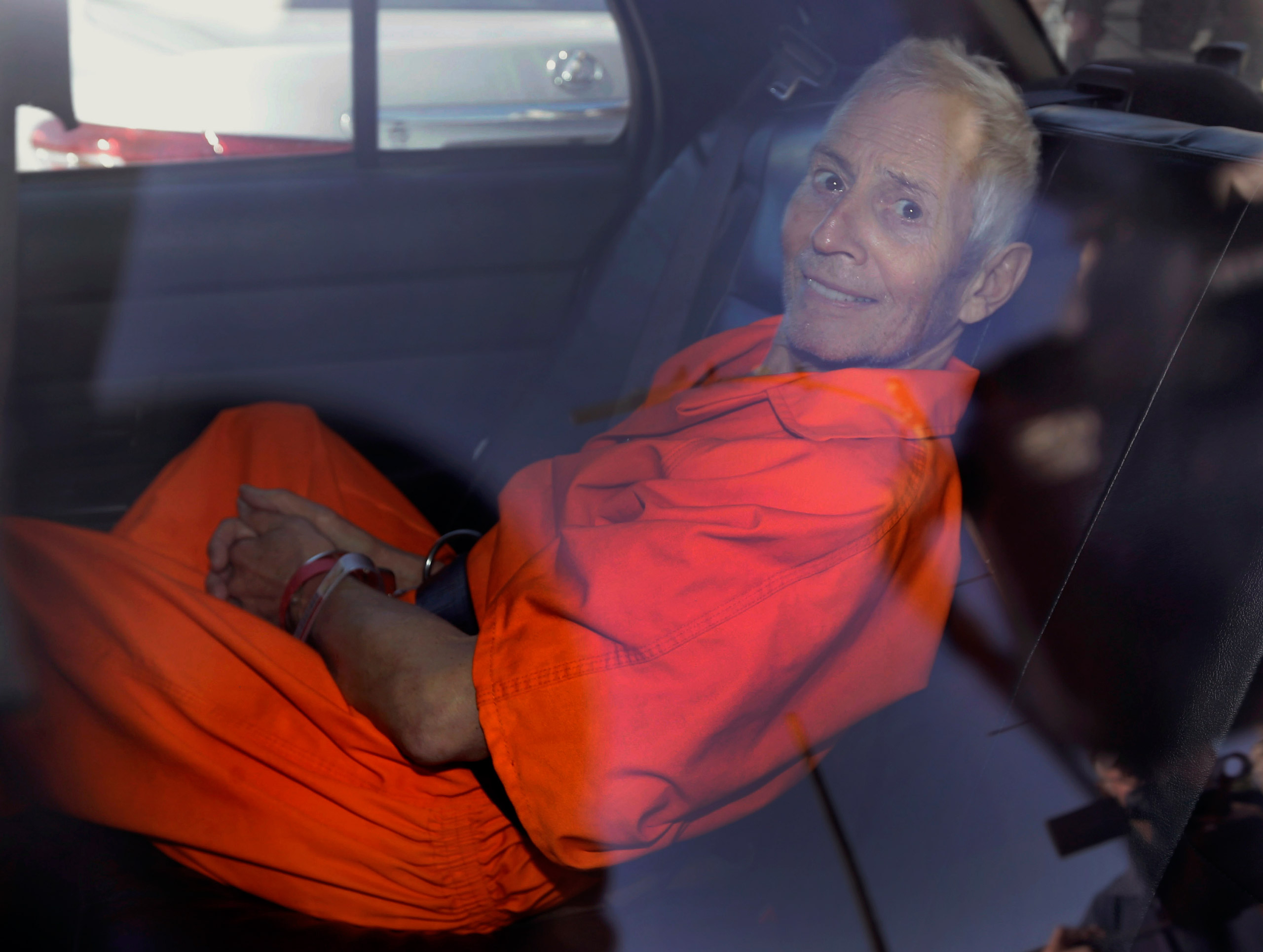 Robert Durst is transported from Orleans Parish Criminal District Court to the Orleans Parish Prison after his arraignment in New Orleans on March 17, 2015.