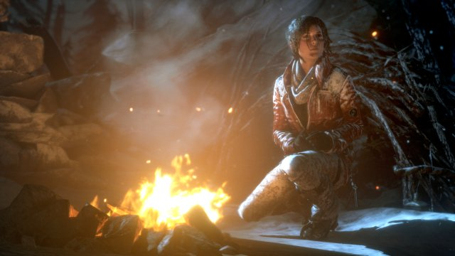 Lara warms herself in front of a campfire as she looks outward into the cold, Siberian night.