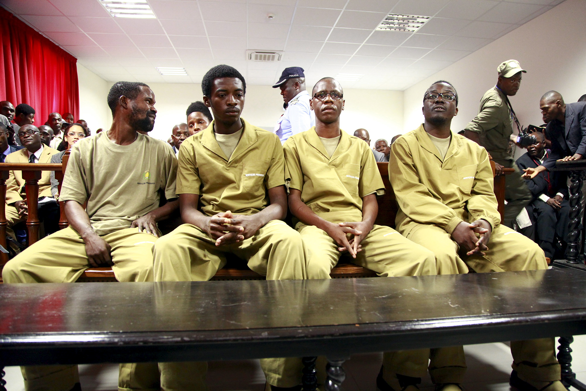 Some of a group of 17 young Angolan activists appear in court in Luanda, Nov. 16, 2015