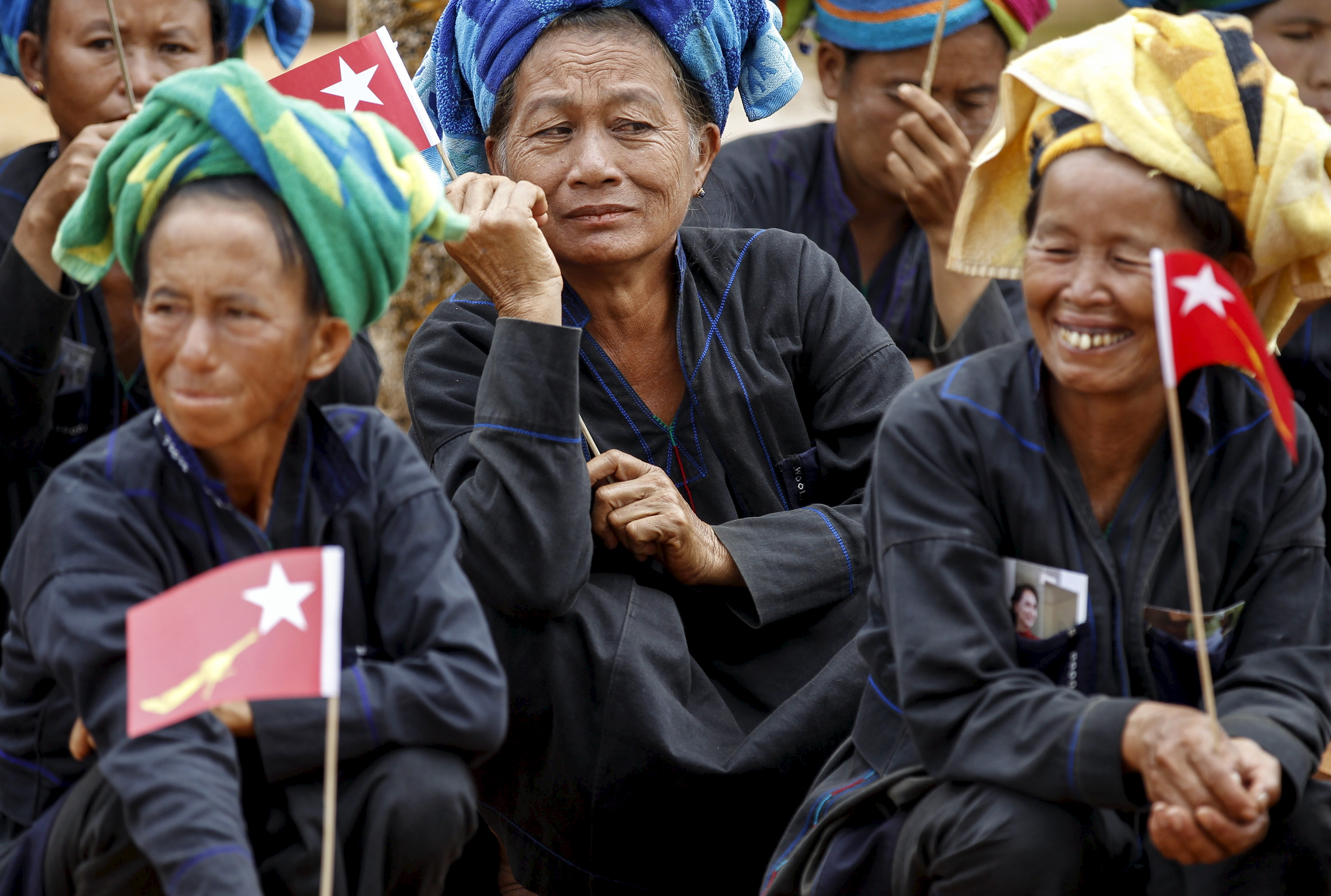 Ethnic Pa'O women sit as they wait for Burmese pro-democracy leader Aung San Suu Kyi to arrive to speak on voter education at the Hsiseng township in Shan state, Myanmar Sept. 5, 2015