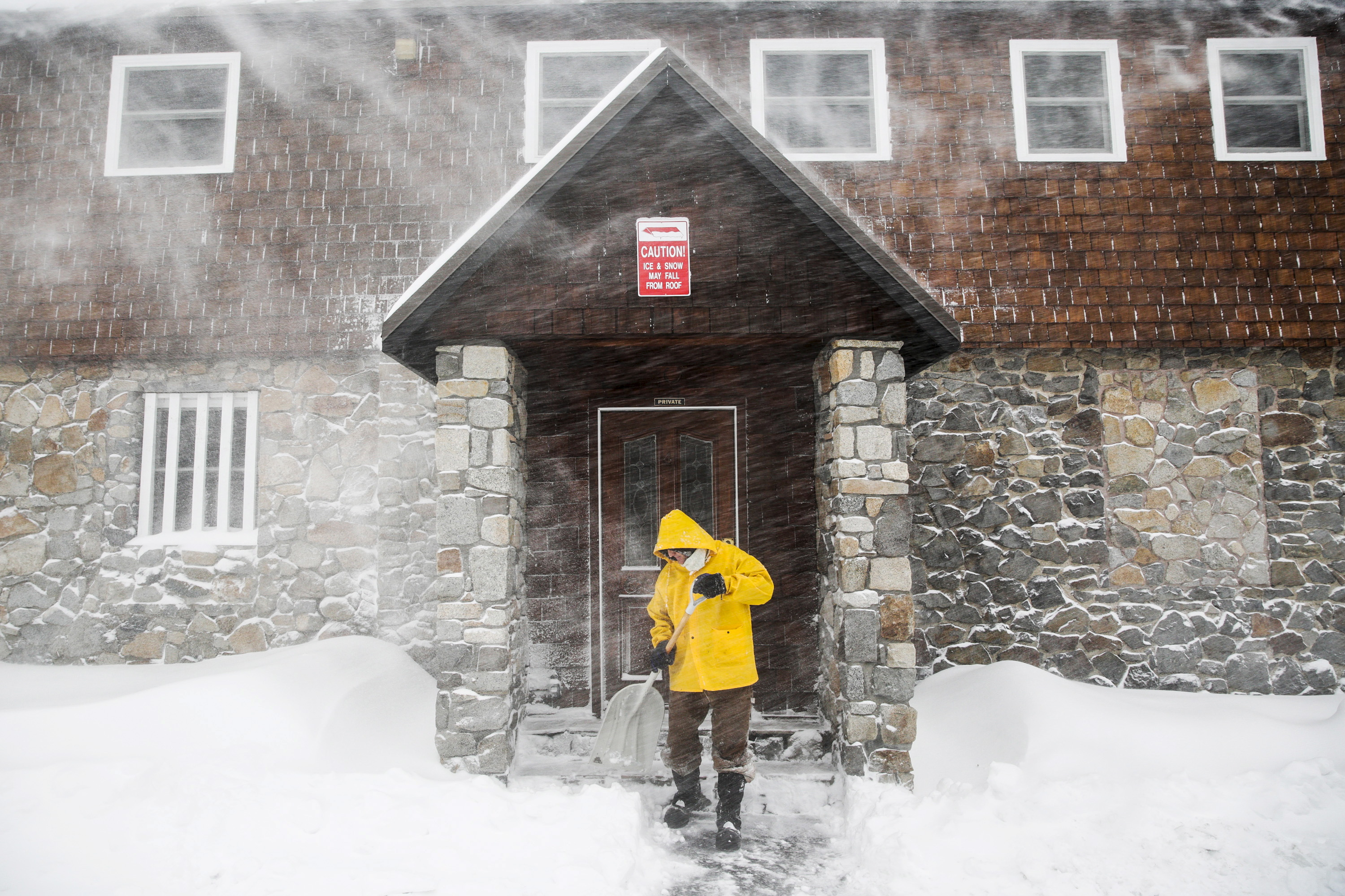 Craig Bentley shovels snow in Soda Springs, California, Nov. 24, 2015