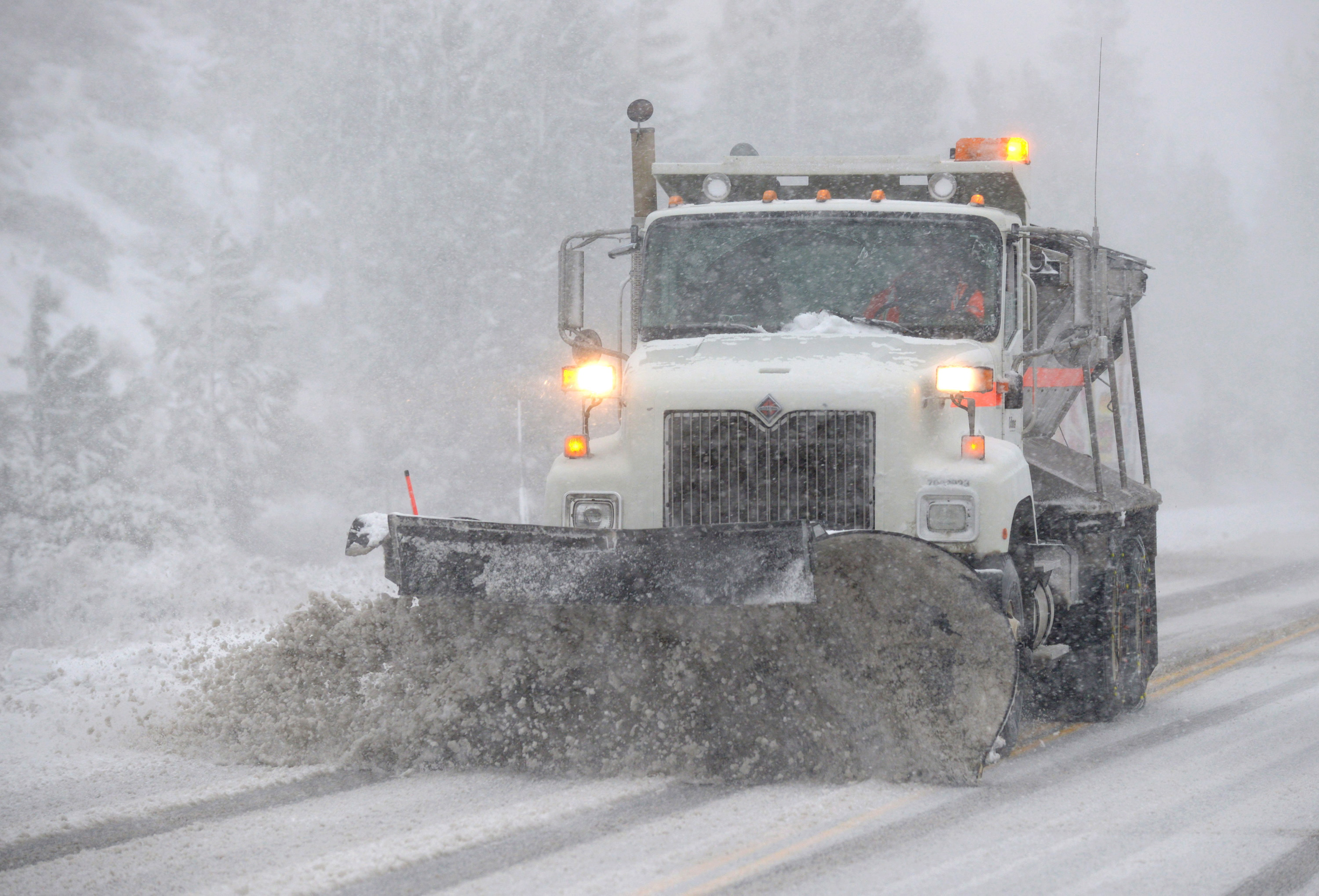 A Caltrans snowplow clears Highway 88 in Woodford, California Nov. 24, 2015