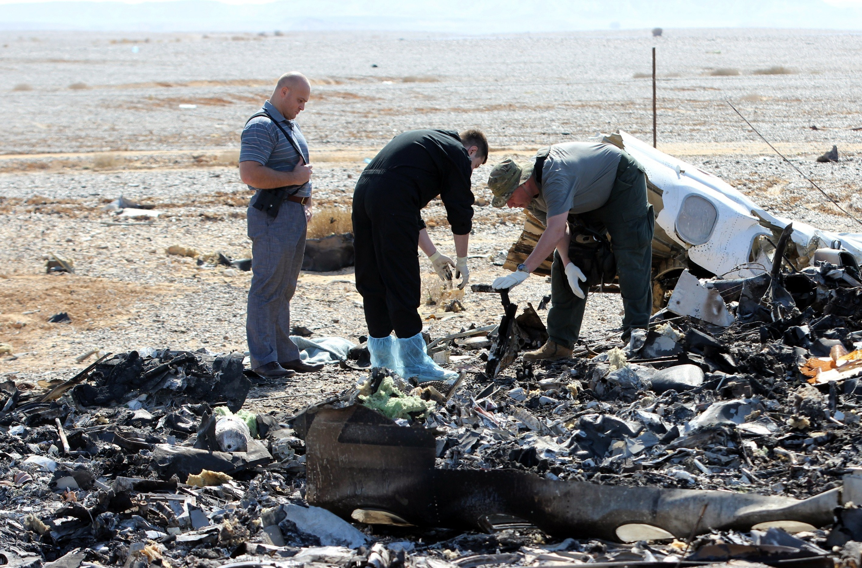 Russian officials inspect the crash site of a Russian Airliner in Suez, Egypt on Nov. 1, 2015. The airliner with 224 people aboard crashed on Egypt's Sinai Peninsula  Saturday.