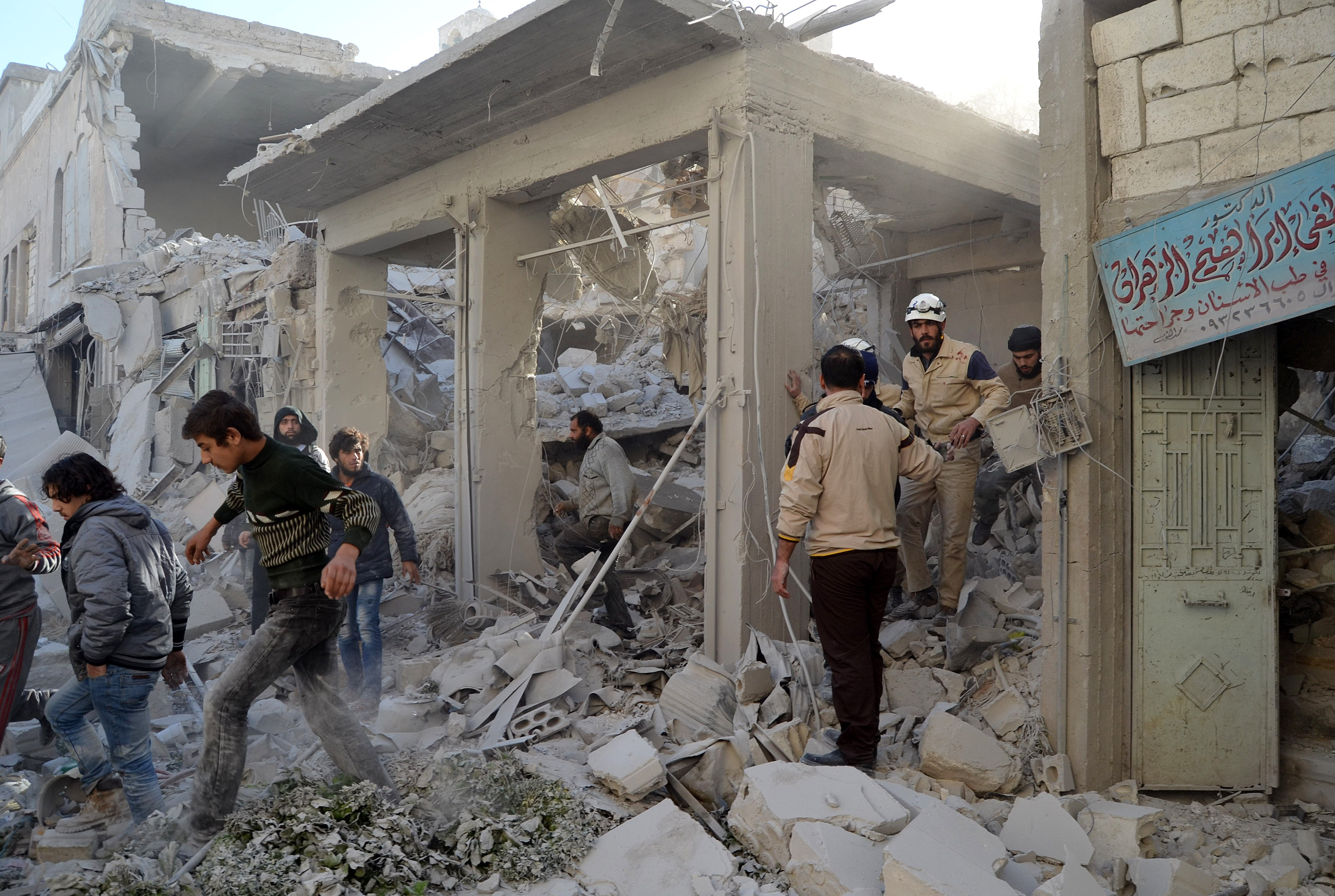Syrian civil defence members search for survivors in the rubble of a building following the Russian airstrikes targeting a market and residential area in Ariha town Idlib, northern Syria on Nov. 29, 2015.