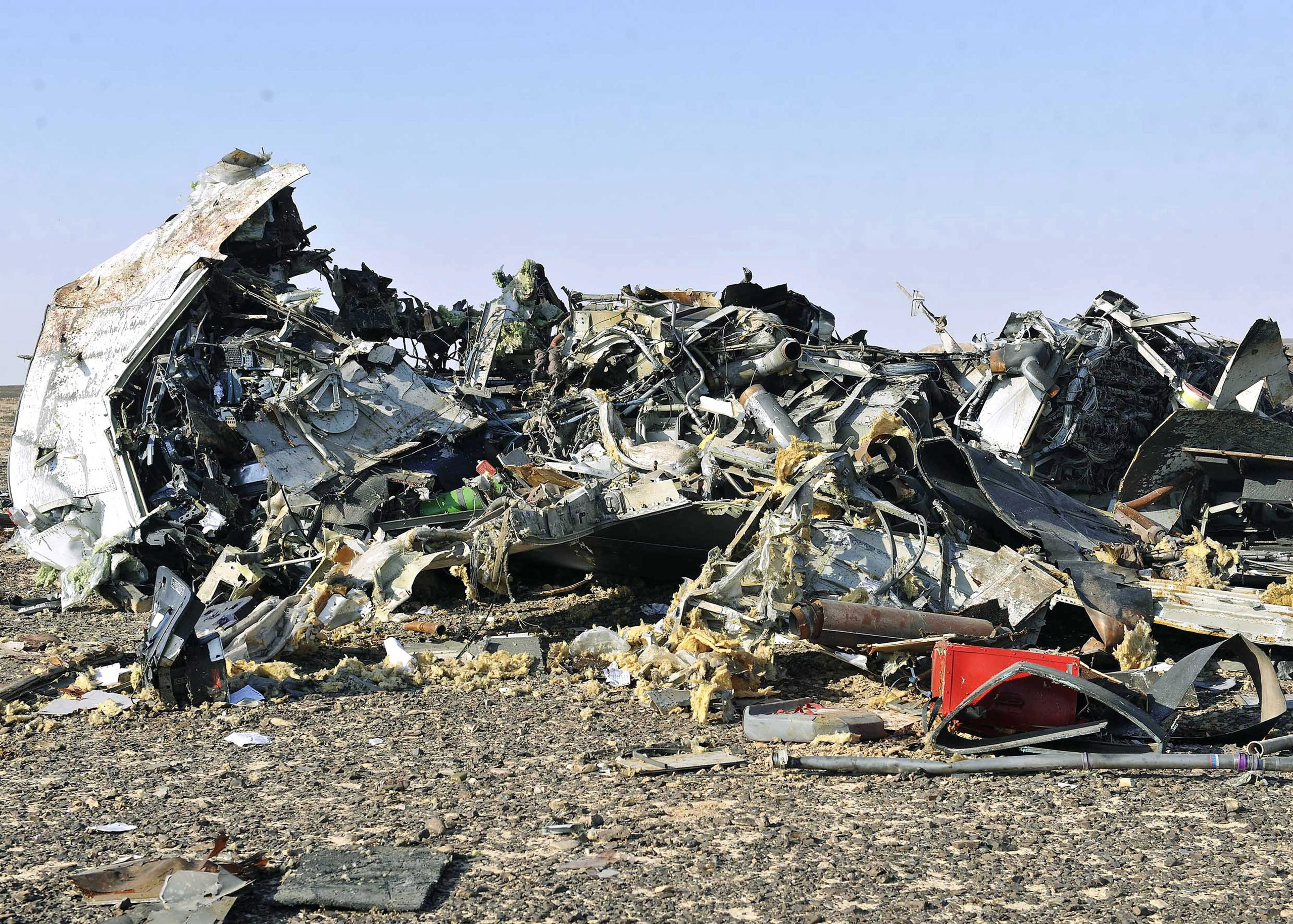 Debris from crashed Russian jet lies strewn across the sand at the site of the crash in the Sinai region in Egypt on Oct. 31, 2015.