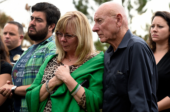 Sandy Phillips, left, and her husband Lonnie, parents of Aurora shooting victim Jessica Ghawi, stand with other family members before addressing members of the media about their reactions to the verdict of life in prison for Aurora Theater shooter James Holmes at the Arapahoe County Justice Center in Centennial, Colorado on August 7, 2015.