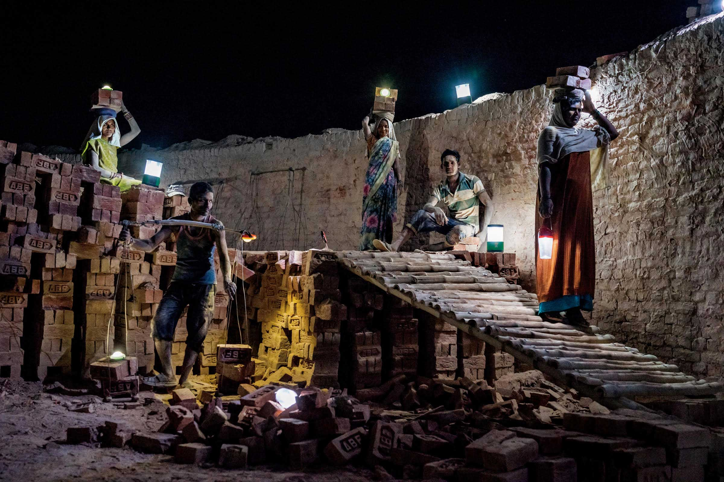 From the November issue of National Geographic magazine:  How Solar Lanterns Are Giving Power to the PeopleAt a brick kiln in India's rural state of Uttar Pradesh, workers use solar lanterns to illuminate their paths.