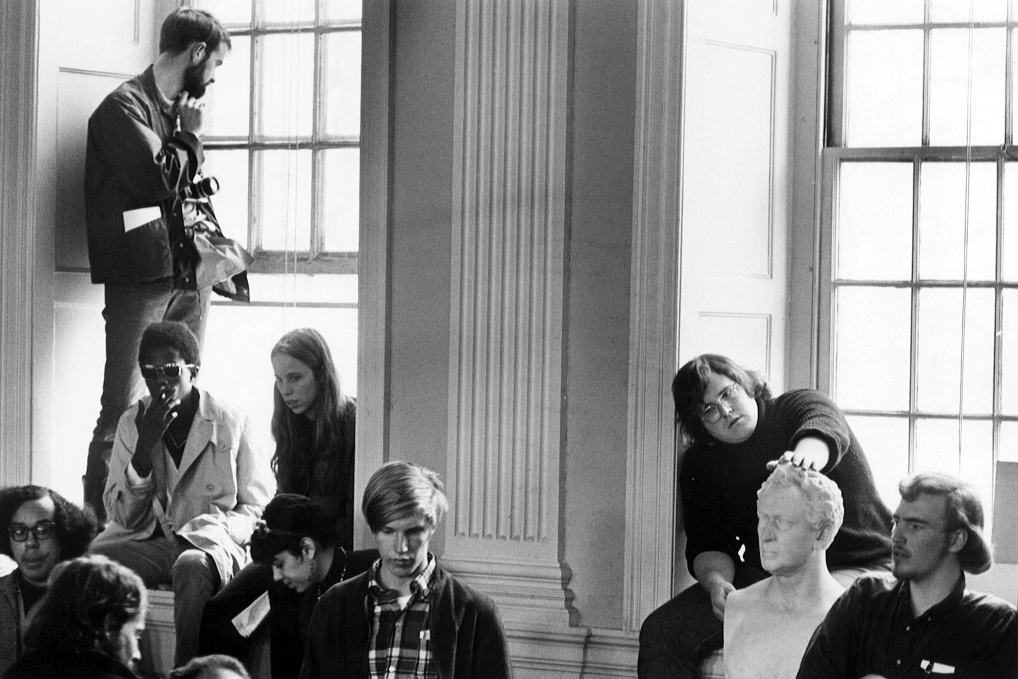 Students occupy Harvard's University Hall during a demonstration on April 9, 1969. As part of the takeover, students removed all Harvard administrators from the building. A massive police raid wrested the protesters from the building, leading to over 300 arrests. The conflicts ultimately led to changes including the establishment of an Afro-American Studies department.
