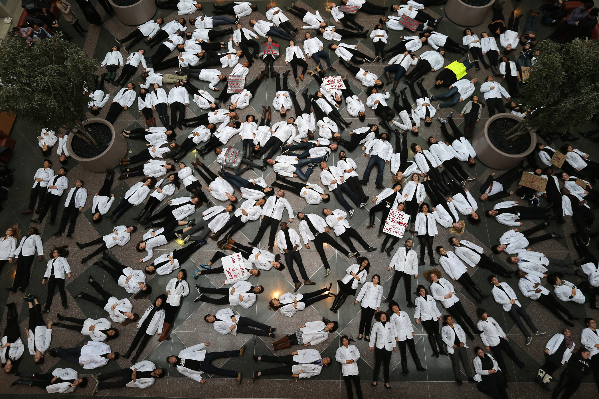 Students participate in a die-in at Harvard Medical School Medical Education Center on Dec. 10, 2014. The protest was held in response to the decisions by authorities to not bring indictments in the police killings of Michael Brown in Ferguson, Mo., and Eric Garner in New York. The Black Lives Matter movement has found support at campus's across the country.