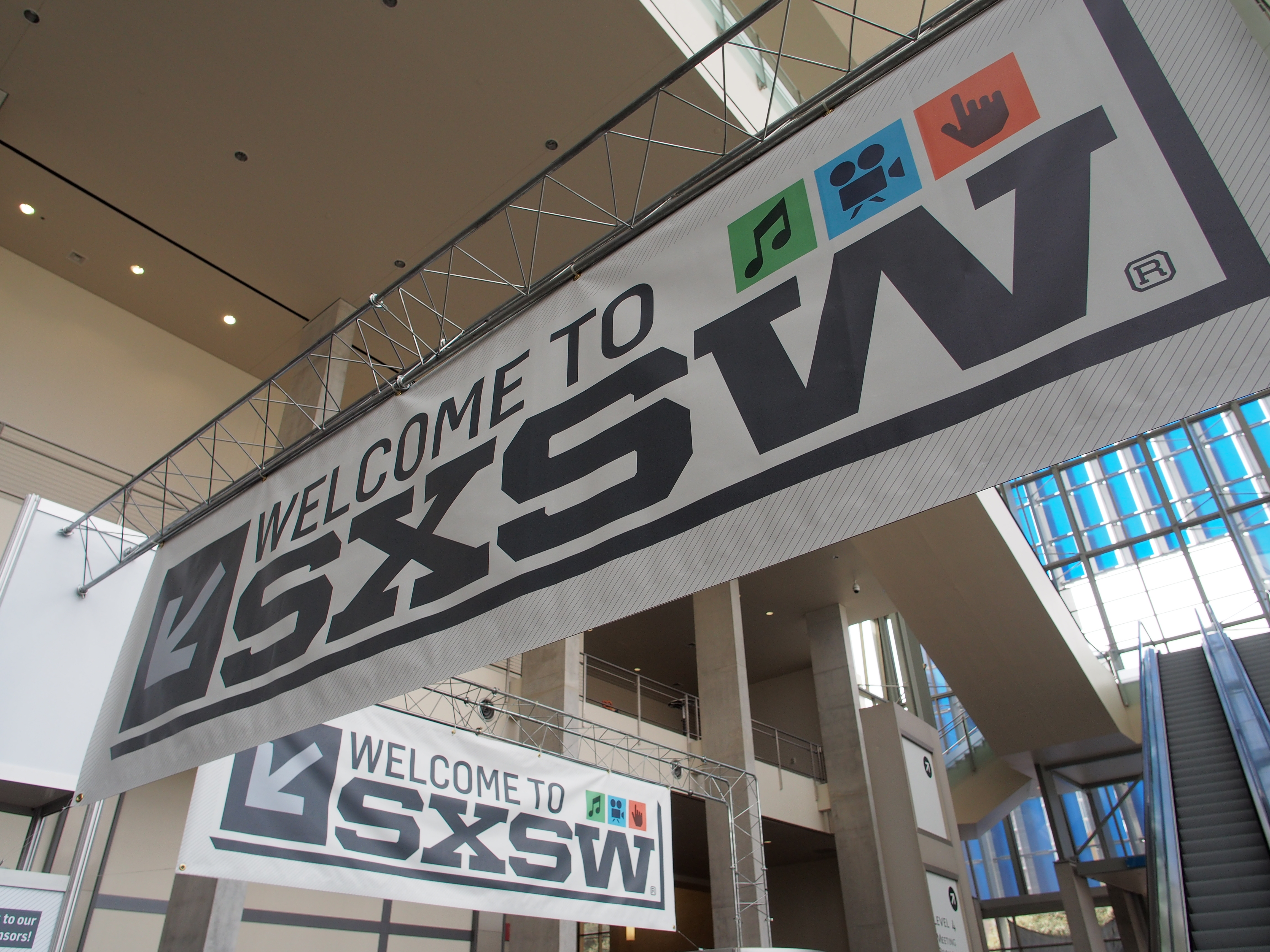 Banners hang in the atrium of the Austin Convention Center on Thursday, March 7, 2012 on the eve of the opening of the 27th South By Southwest (SXSW) interactive, film and music festival.