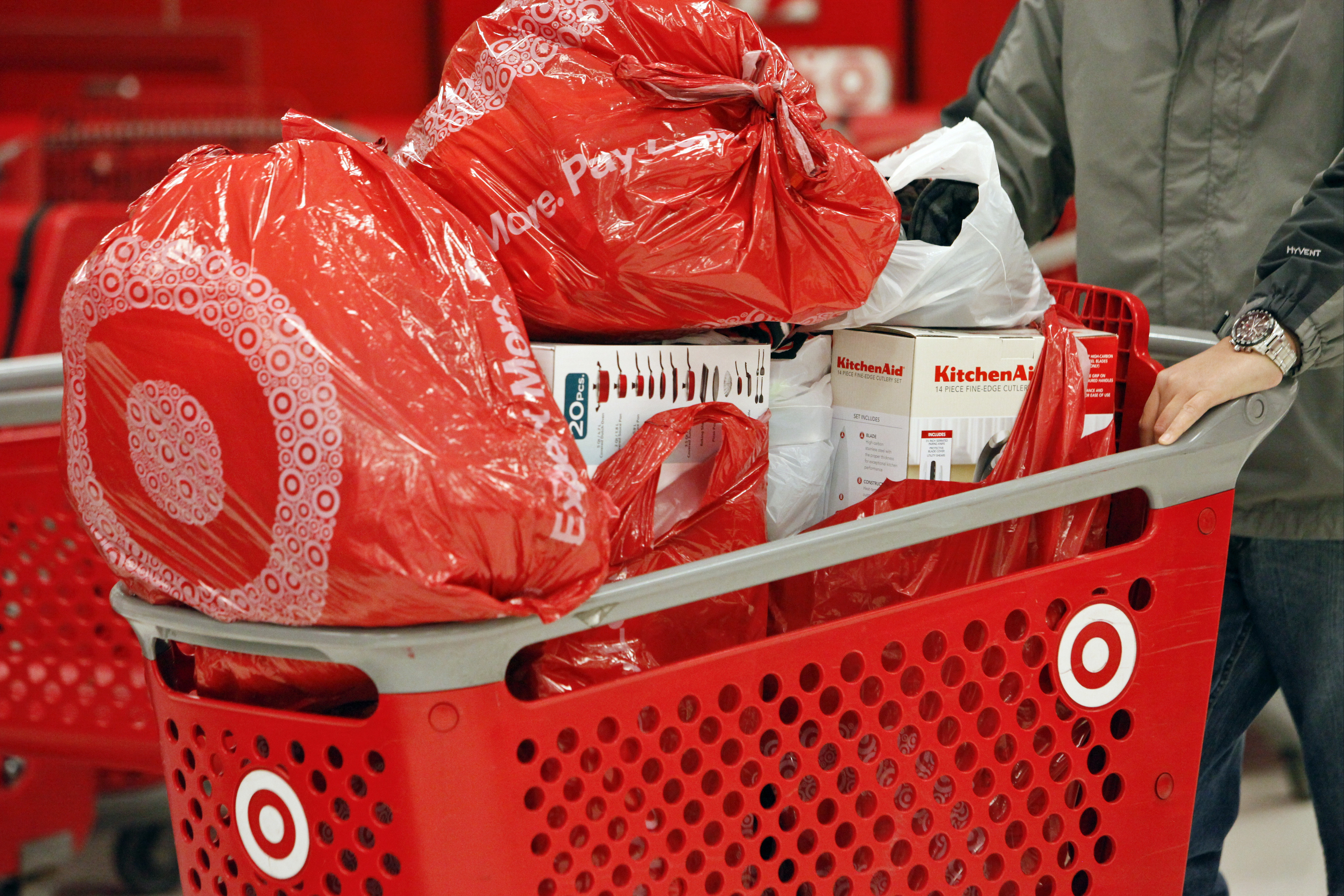 A customer pushes a shopping cart laden with merchandise at a Target Corp. store opening ahead of Black Friday in Chicago, Illinois, U.S., on Thursday, Nov. 28, 2013.