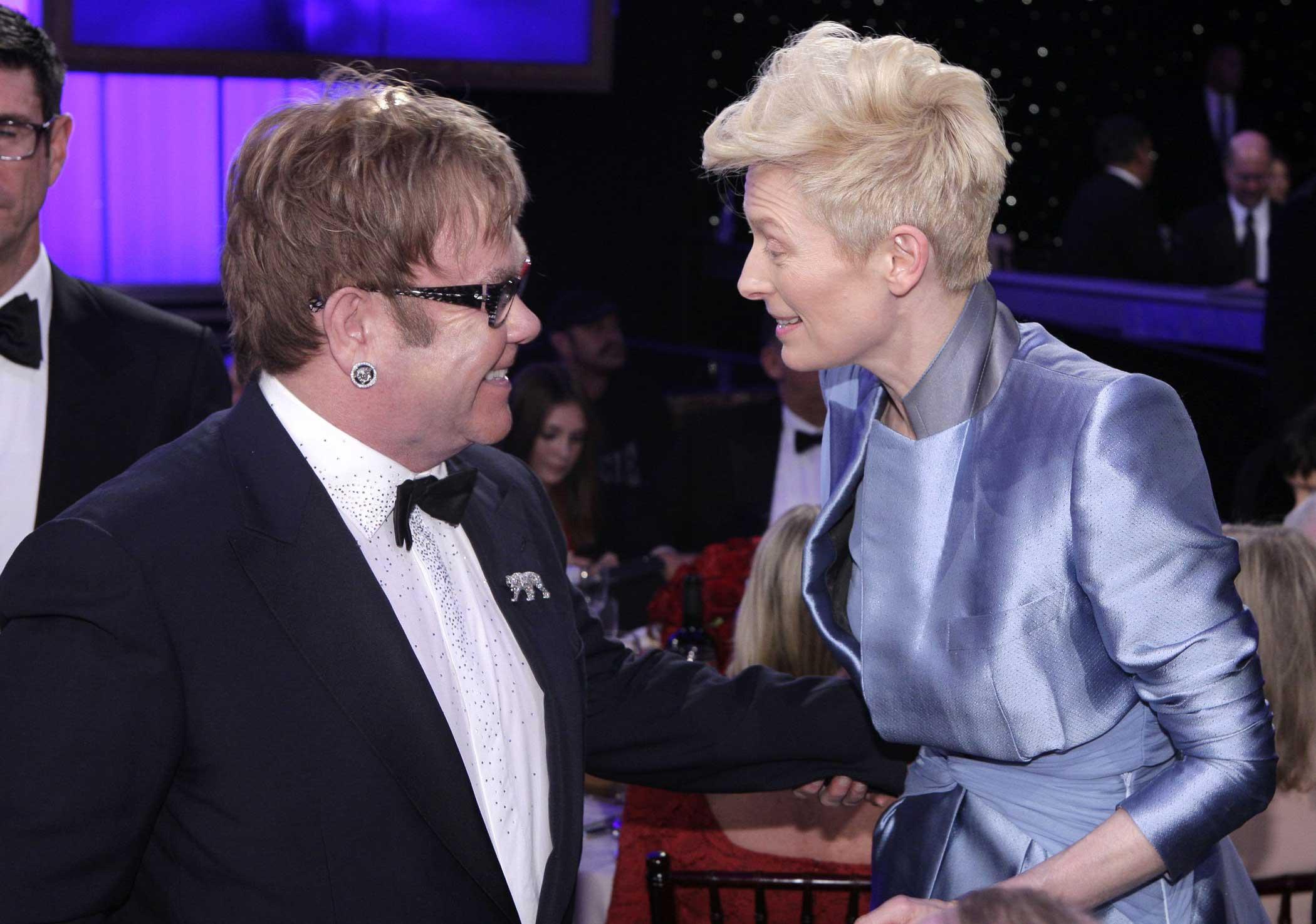 Elton John and Tilda Swinton during the 69th Annual Golden Globe Awards on Jan. 15, 2012 in Beverly Hills, Calif.