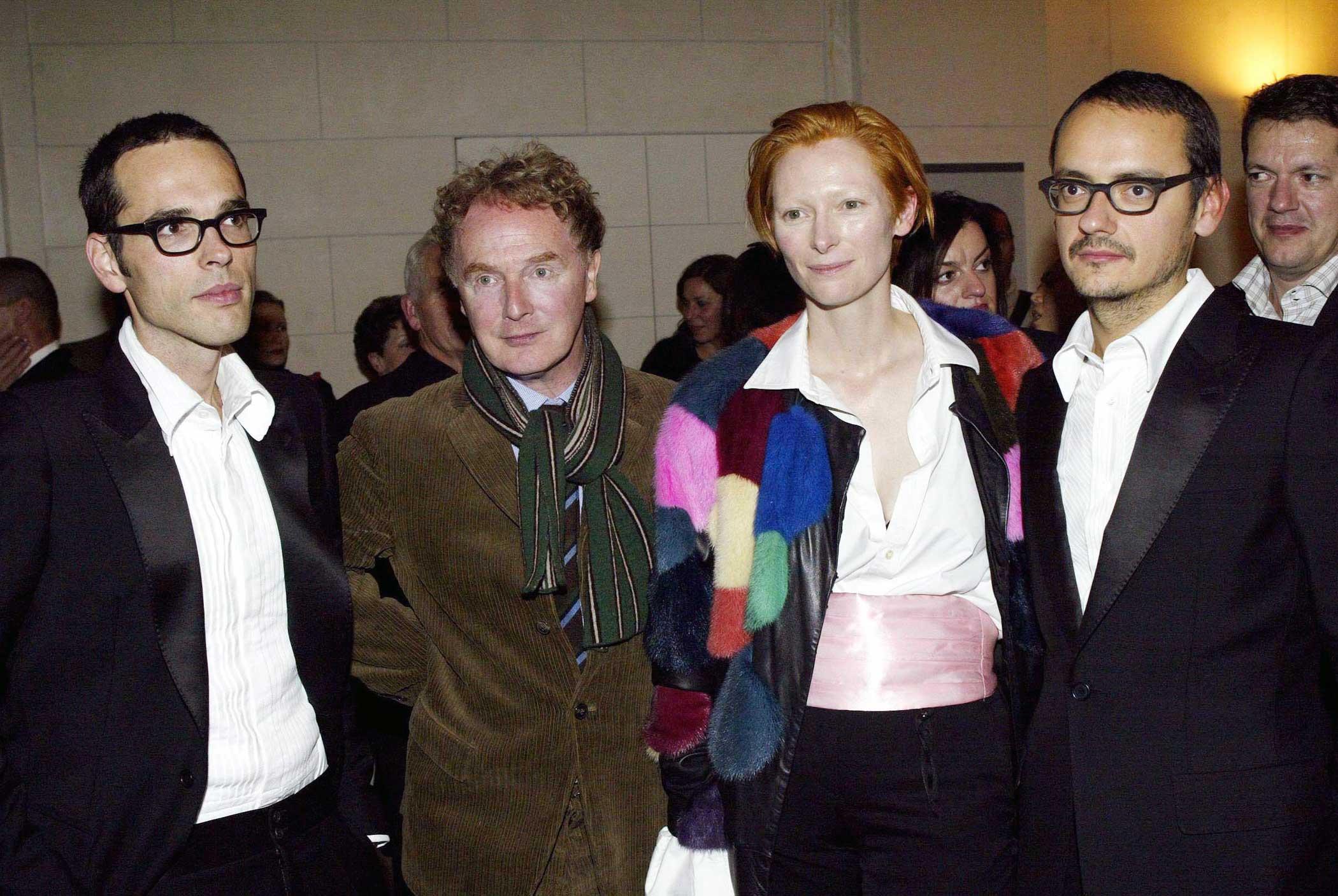 Malcom McLaren, second from left, Tilda Swinton, and Viktor & Rolf on Aug. 10, 2003 in Paris.