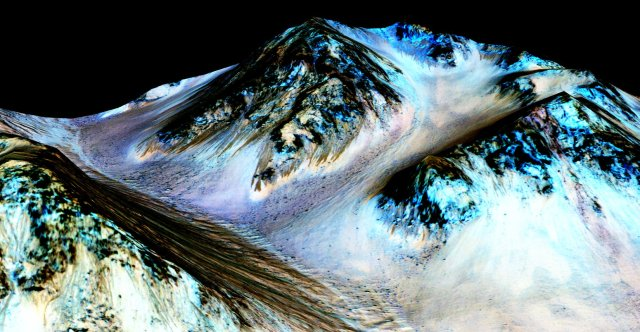 In this handout provided by NASA's Mars Reconnaissance Orbiter, dark, narrow streaks on the slopes of Hale Crater are inferred to be formed by seasonal flow of water on surface of present-day Mars.