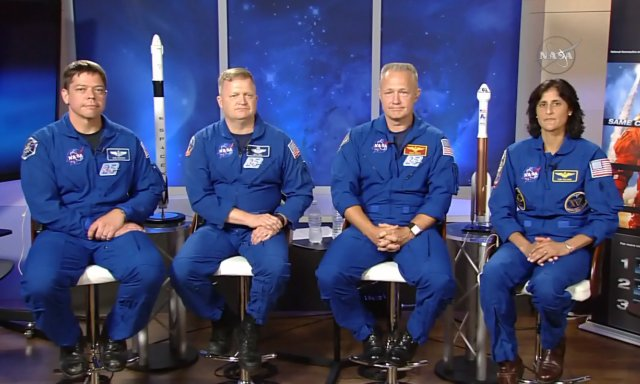 In this image made from a video provided by NASA, astronauts, from left, Bob Behnken, Eric Boe, Doug Hurley and Suni Williams gather for an interview at the Johnson Space Center in Houston on July 10, 2015.