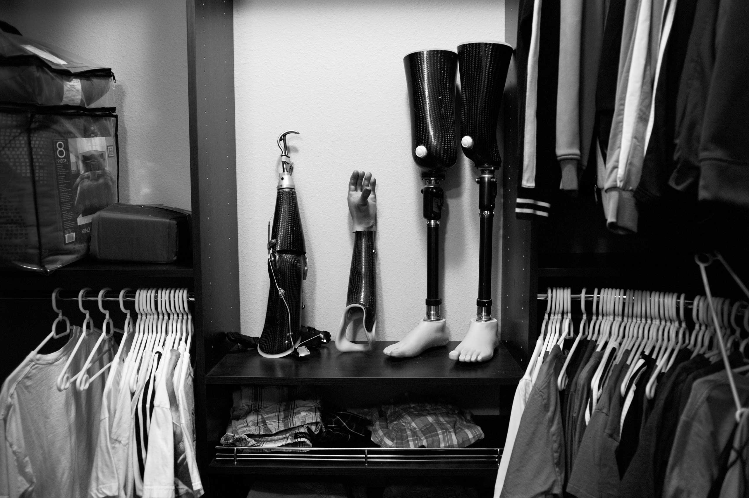 Nicely's store his prosthesis in his closet. He uses his artificial arms and legs interchangeably depending on his daily needs. Lake Ozark, Miss., 2014.