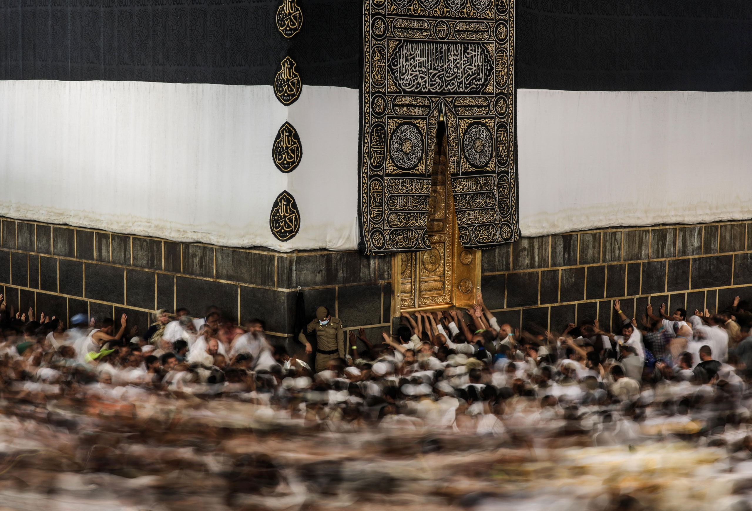 Muslim pilgrims circle the Kaaba, the cube-shaped building at the Grand Mosque in the Muslim holy city of Mecca, while performing Tawaf, an anti-clockwise movement around the Kaaba and one of the main rites of the annual pilgrimage, known as Hajj. Mecca, Saudi Arabia. Sept. 21, 2015.