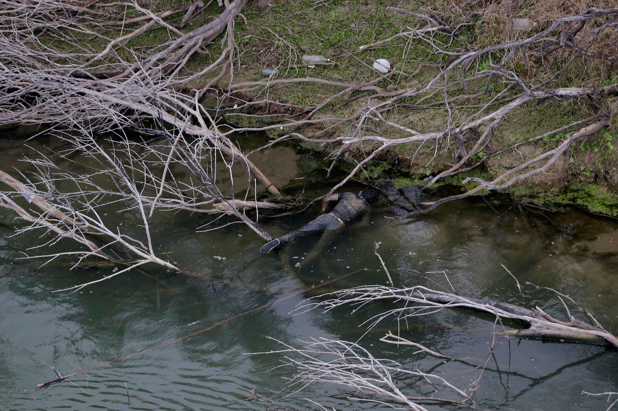 A body discovered by the U.S. Customs and Border Protection Air and Marine while on patrol near the Texas-Mexico border floats in the Rio Grande, in Rio Grande City, Texas. Feb. 24, 2015.