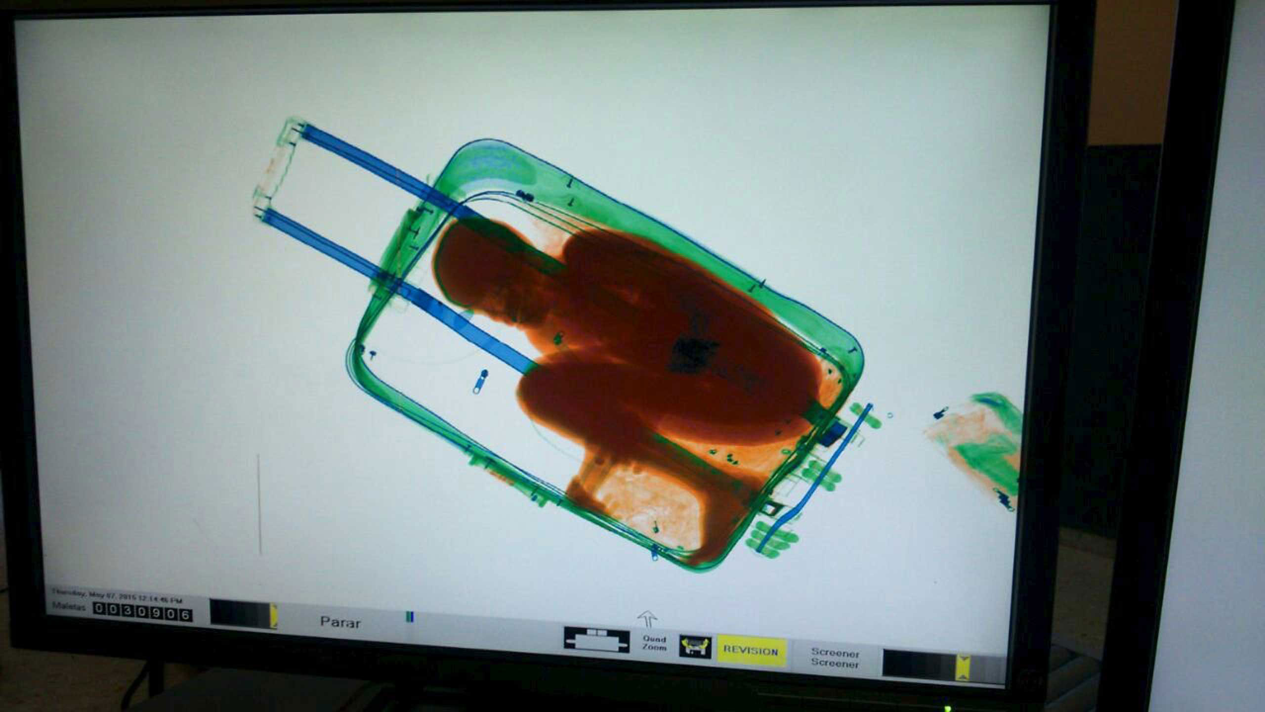 The figure of an 8-year-old boy is seen inside a suitcase on a Spanish civil guard scanner screen, at the border between Morocco and Spain's North African enclave Ceuta, Spain. May 8, 2015.