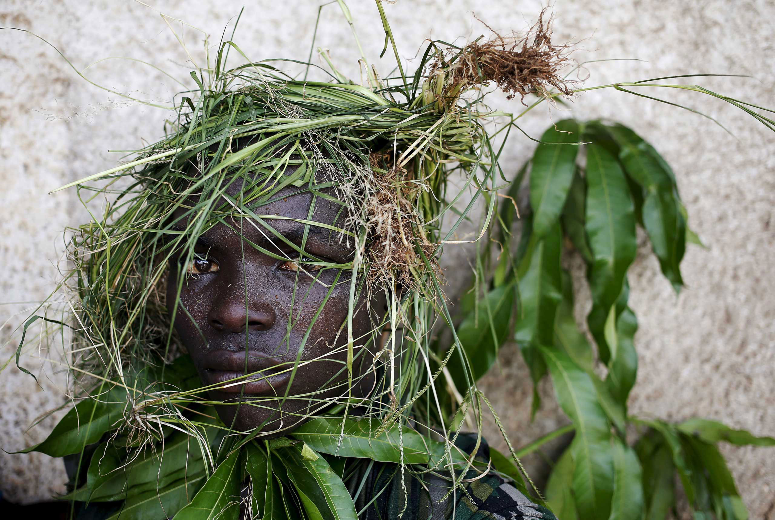 In this unranked gallery, TIME presents the top 100 photos of the yearA protester wears grass around his face to obscure his identity during a protest against President Pierre Nkurunziza's decision to run for a third term, in Bujumbura, Burundi. May 11, 2015.