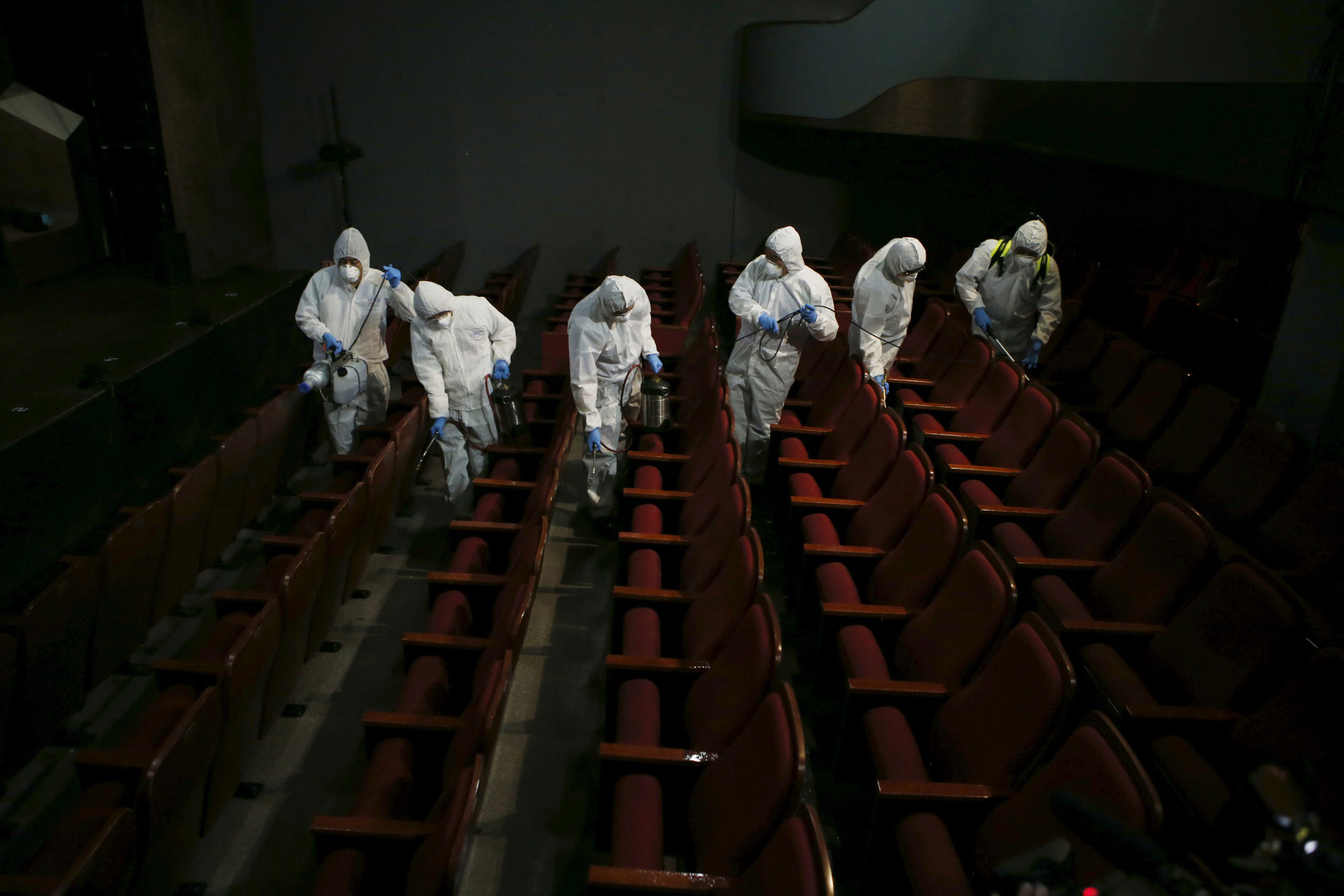 Employees from a disinfection service company sanitize the interior of a theater in Seoul, South Korea. June 18, 2015.