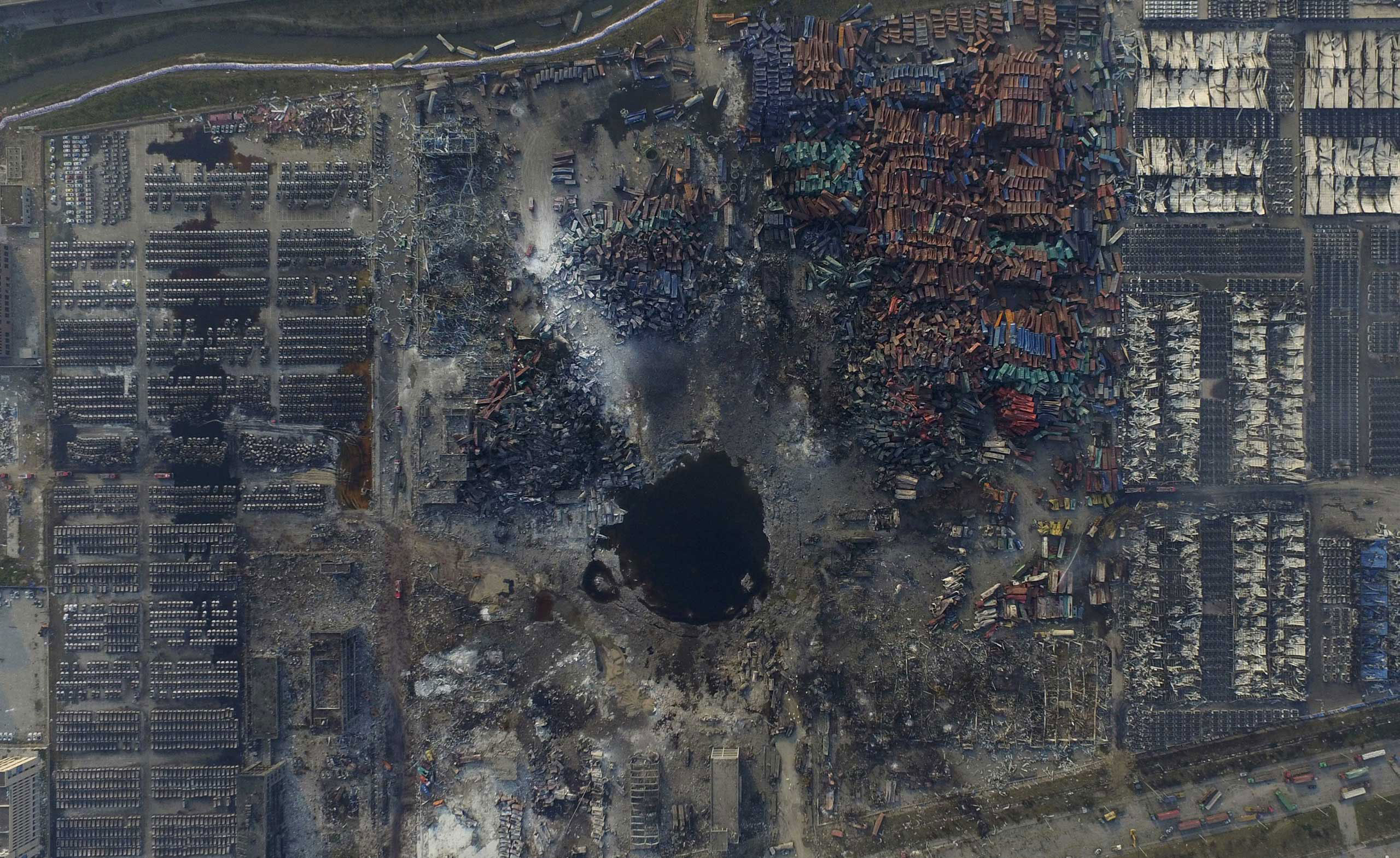 An aerial picture of the site of explosions at the Binhai new district, Tianjin, China. The blasts devastated a large industrial site and nearby residential areas, forcing the evacuation of thousands of people after toxic chemicals were detected in the air. Aug. 16, 2015.
