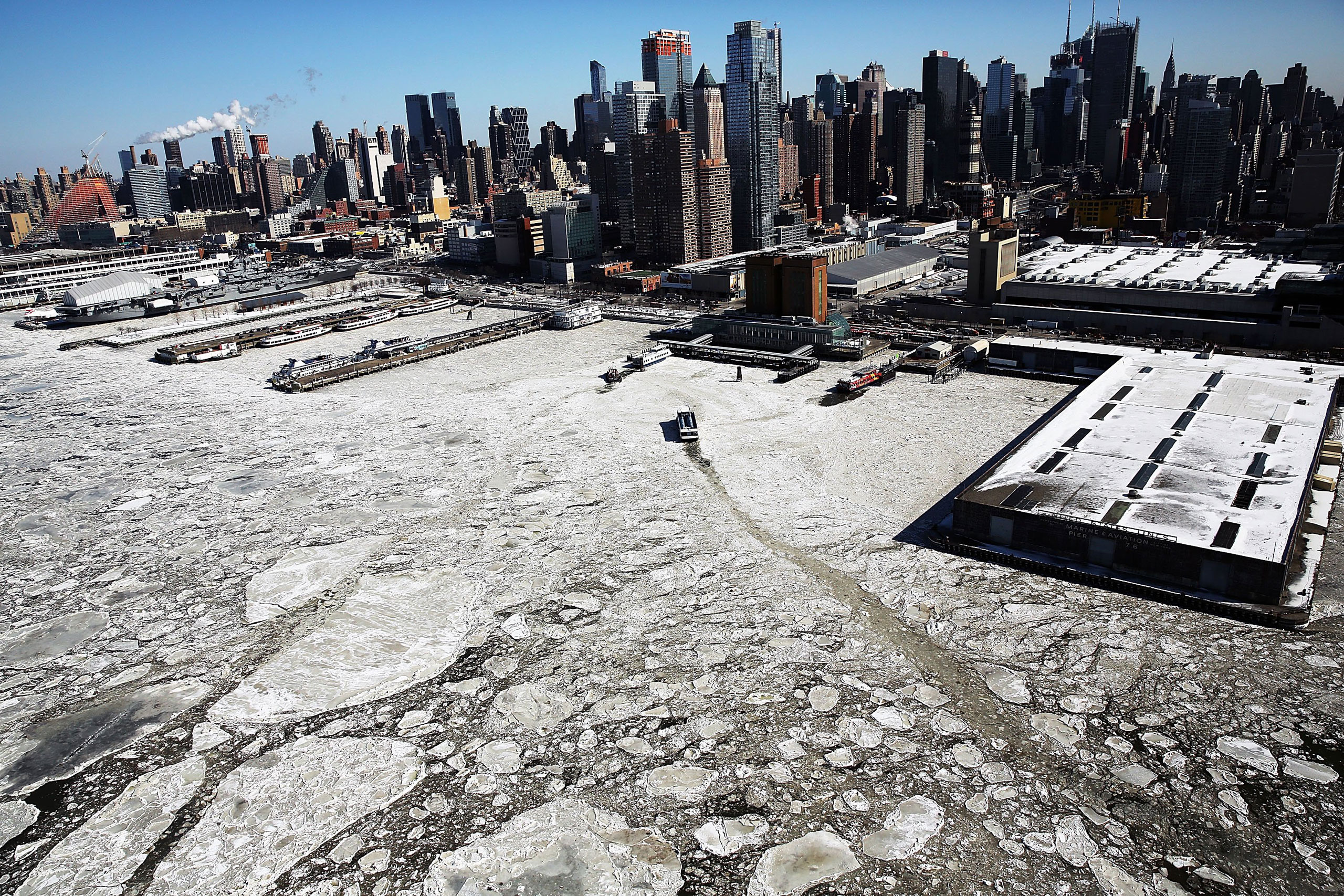 Ice floes are viewed along the Hudson River in Manhattan on a frigidly cold day.  New York. Feb. 20, 2015. Much of the East Coast and Western United States experienced unusually cold weather during the winter of 2015, with temperatures in the teens and the wind chill factor making it feel well below zero.