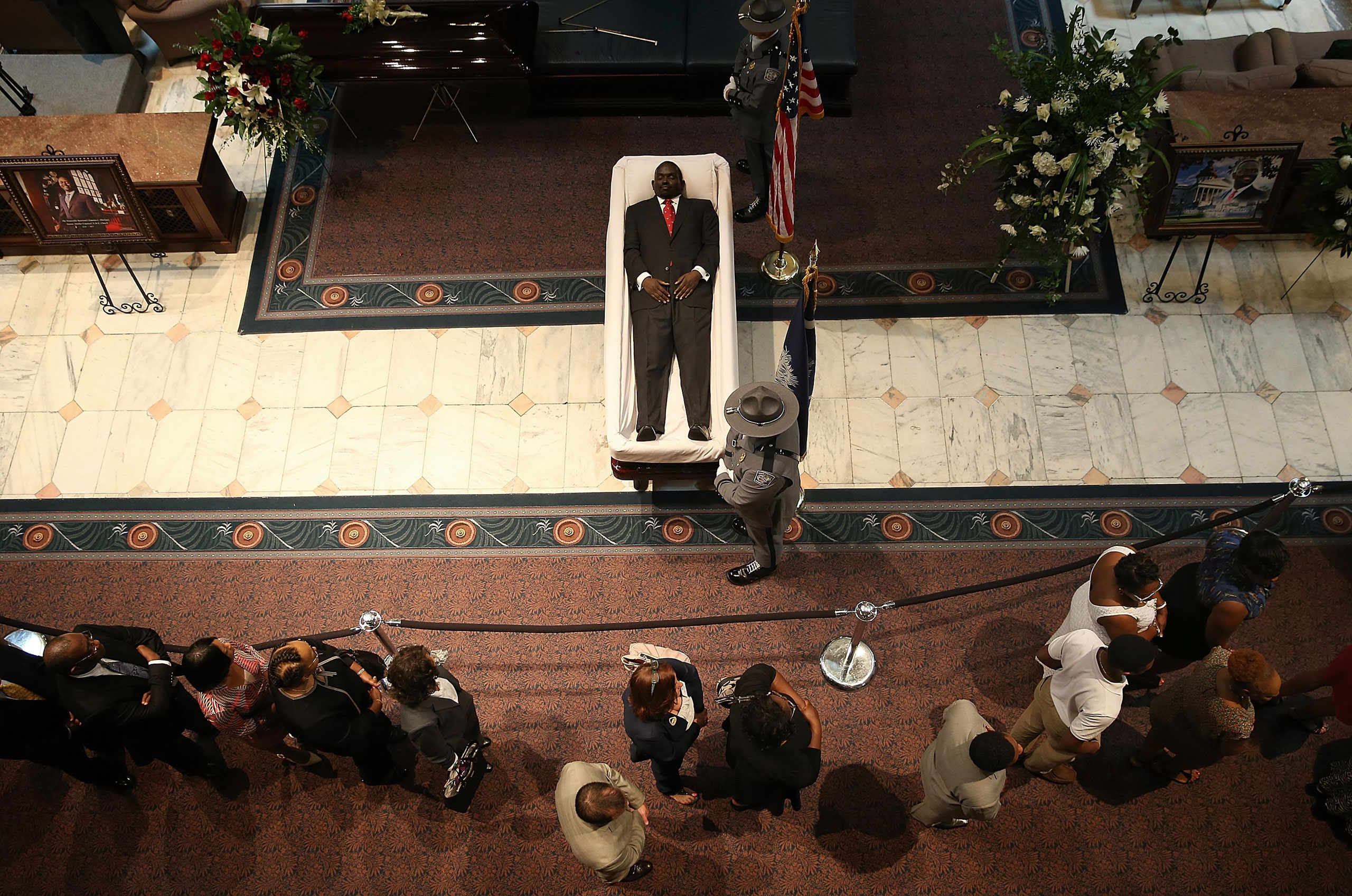 Visitors pay their respects during an open viewing for Rev. Clementa Pinckney at the South Carolina State House. Columbia, S.C. June 24, 2015.                                 Pinckney was one of nine people killed during a Bible study inside Emanuel AME church in Charleston.