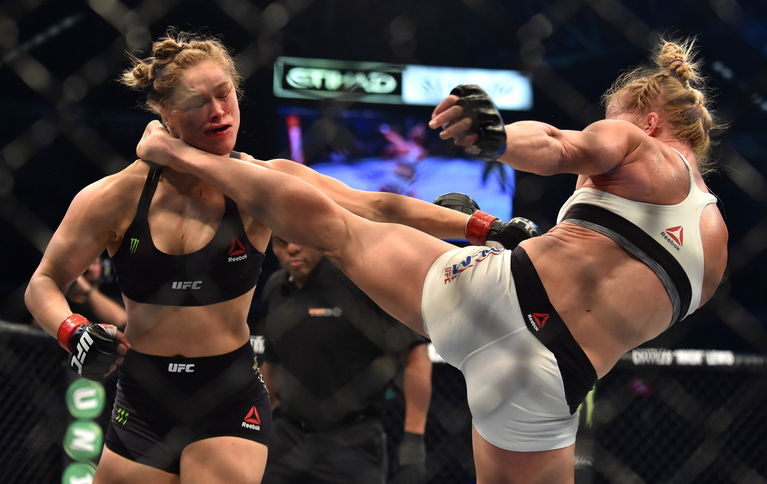 Holly Holm of the U.S. (pictured right) lands a kick to the neck to knock out compatriot Ronda Rousey and wins the Ultimate Fighting Championship (UFC) title fight in Melbourne, Australia. Nov. 15, 2015.