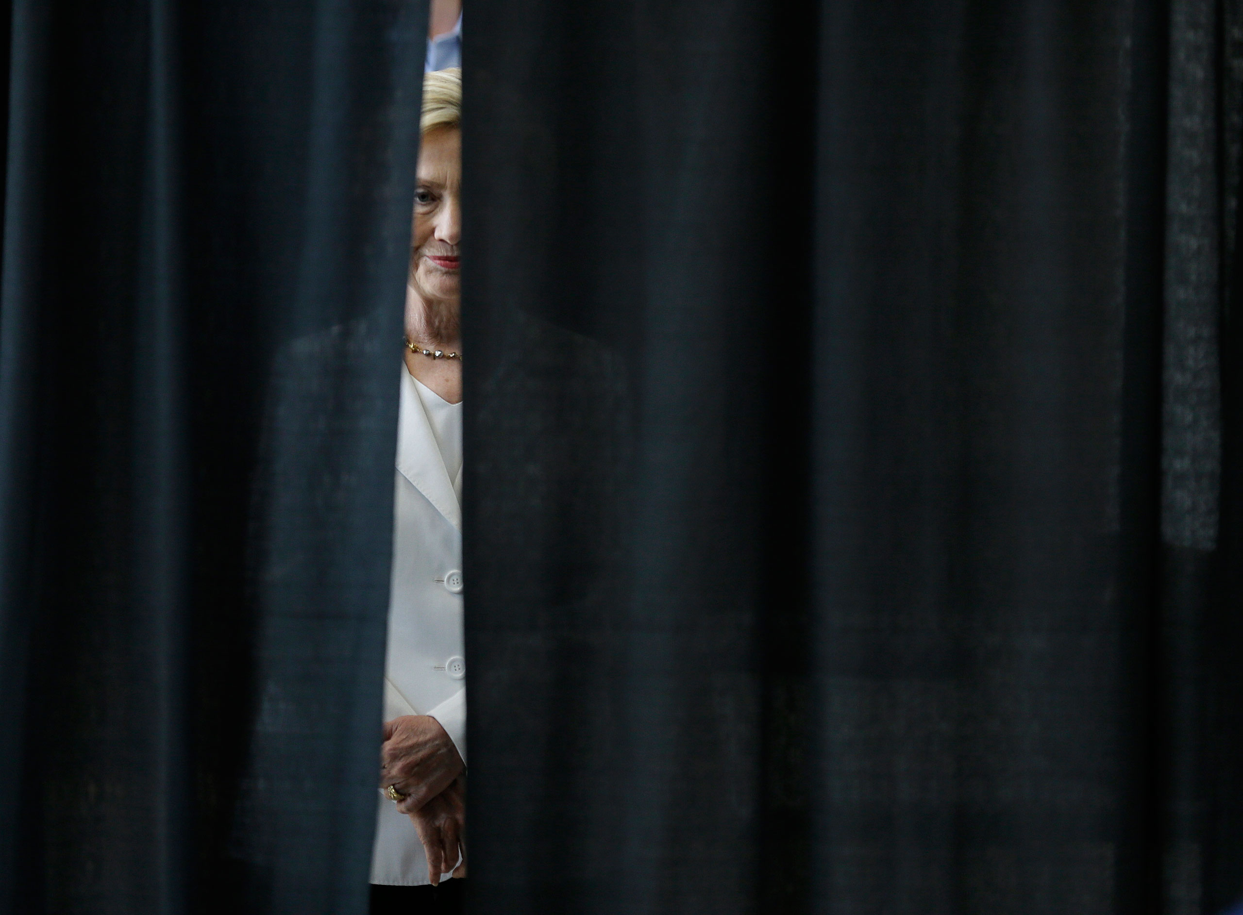 Democratic presidential candidate Hillary Rodham Clinton waits to be introduced before speaking about rural issues at the Des Moines Area Community College, in Ankeny, Iowa. Aug. 26, 2015.