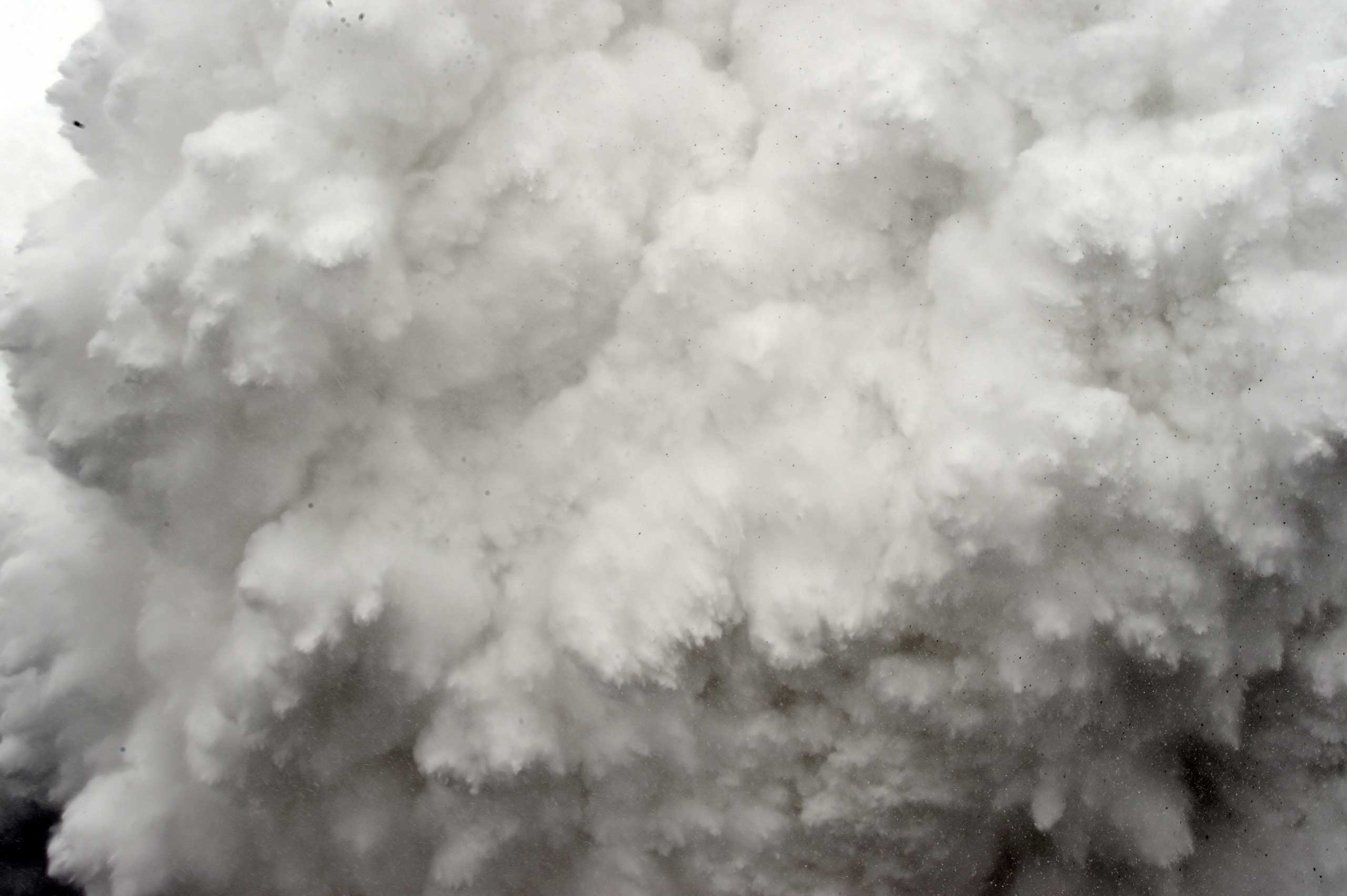A cloud of snow and debris triggered by an earthquake flies towards Everest Base Camp, moments ahead of flattening part of the camp in the Himalayas.   Rescuers in Nepal search frantically for survivors of a huge quake that killed nearly 2,000, digging through rubble in the devastated capital Kathmandu and airlifting victims of an avalanche at Everest base camp. April 25, 2015.