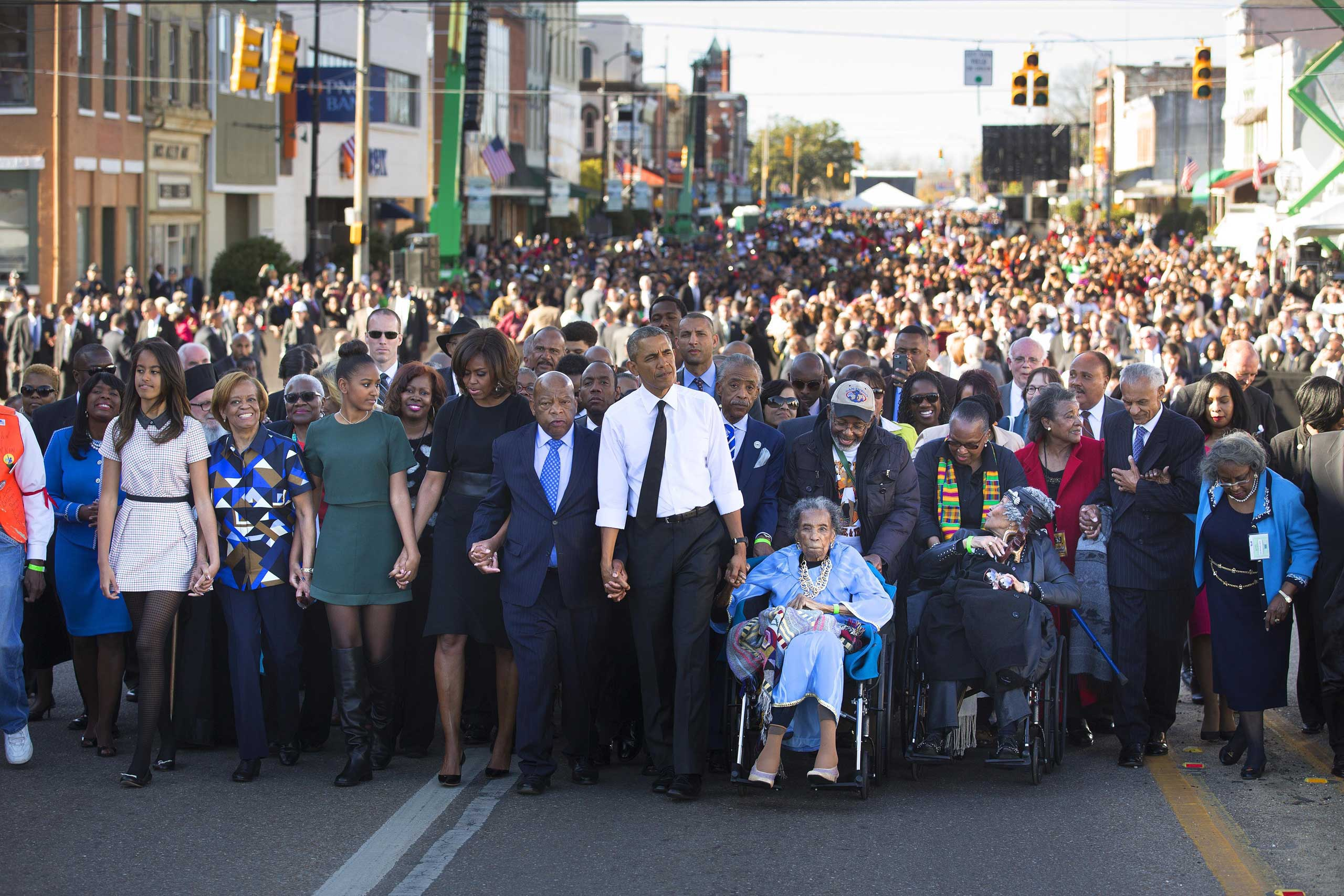 President Barack Obama, Amelia Boynton, right, Rep. John Lewis (D-Ga.) and the first family lead a march toward the Edmund Pettus bridge, 50 years to the day after Bloody Sunday in Selma, Ala. In an address, Obama rejected the notion that race relations have not improved in the years since—as well as the notion that racism has been defeated. March 7, 2015.