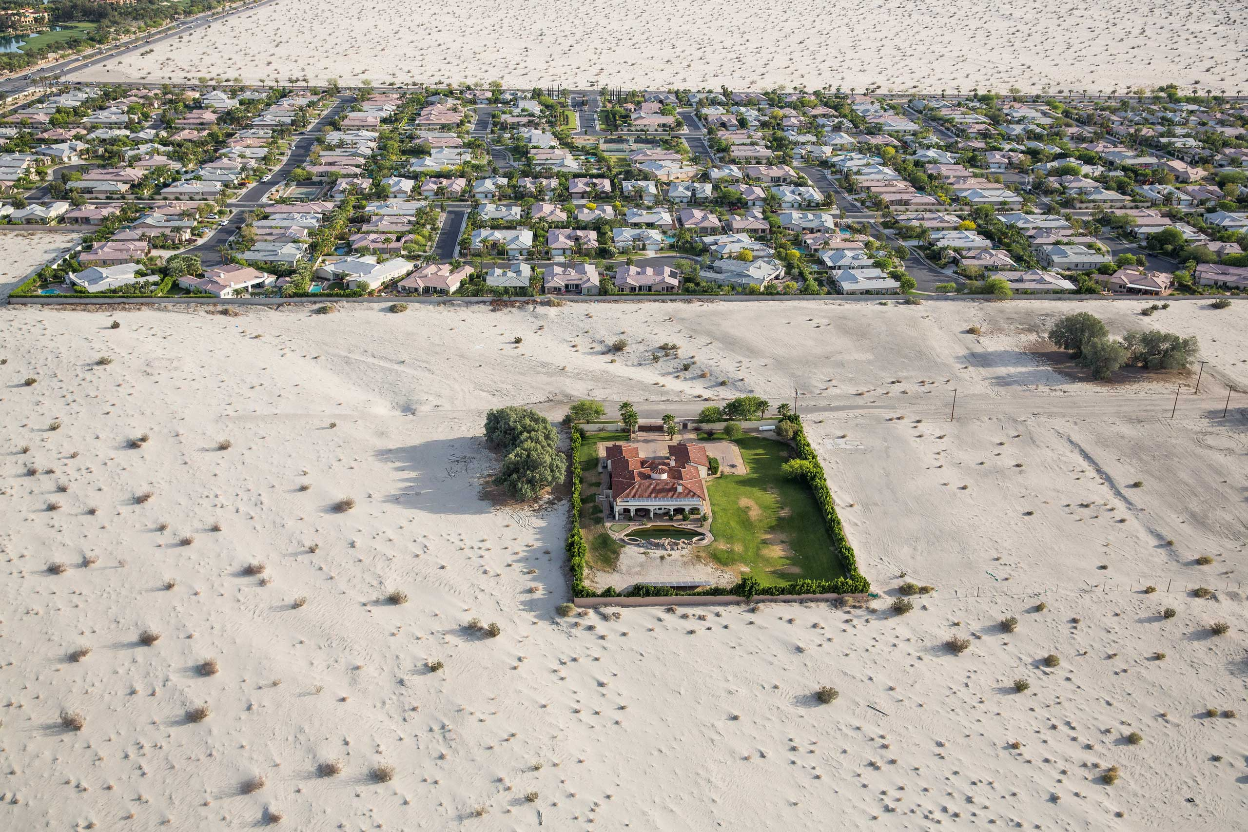 Properties surrounded by desert in Rancho Mirage, Calif. The state's history as a frontier of prosperity and glamour faces an uncertain future as the fourth year of severe water shortages has prompted Gov. Jerry Brown to mandate a 25 percent reduction in non-agricultural water use. April 3, 2015.