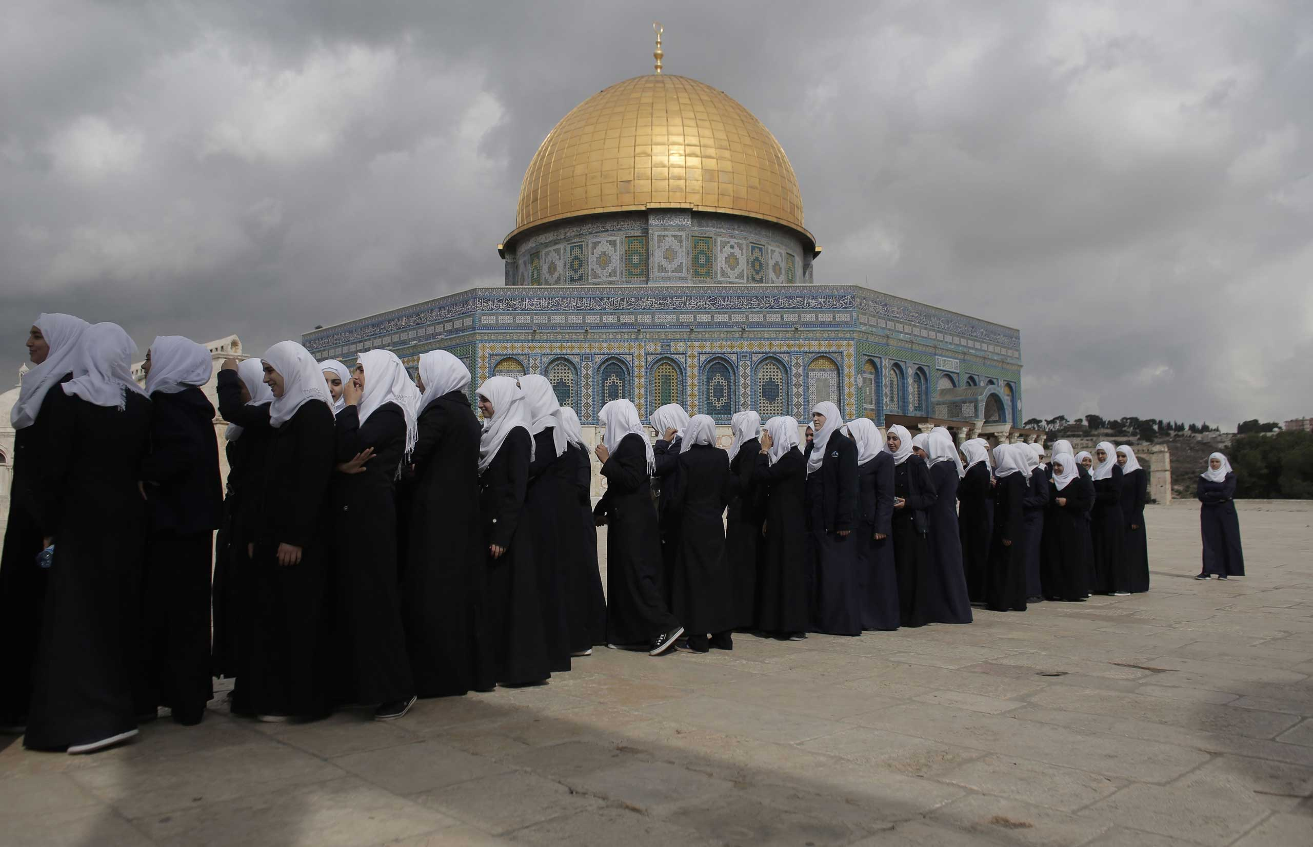 Palestinian school girls walk in line past the Dome of the Rock at the Al-Aqsa mosque compound in Jerusalem's Old City. Israeli Prime Minister Benjamin Netanyahu scrambled to contain inflammatory rhetoric from his government over the holy site, which is sacred to both Muslims and Jews, at the heart of a wave of deadly Palestinian unrest. Oct. 27, 2015.