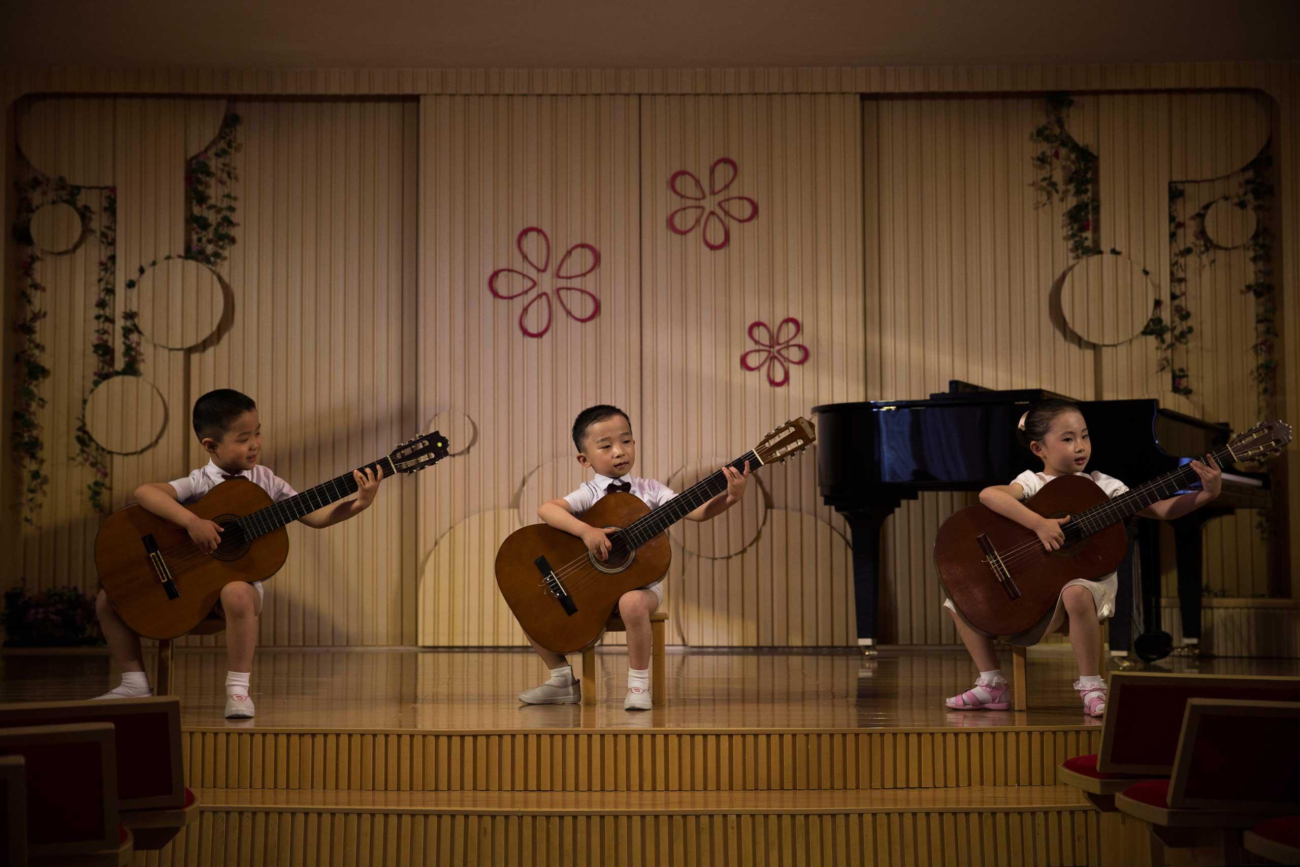 North Korean children perform at the Pyongyang Kyongsang Kindergarten.