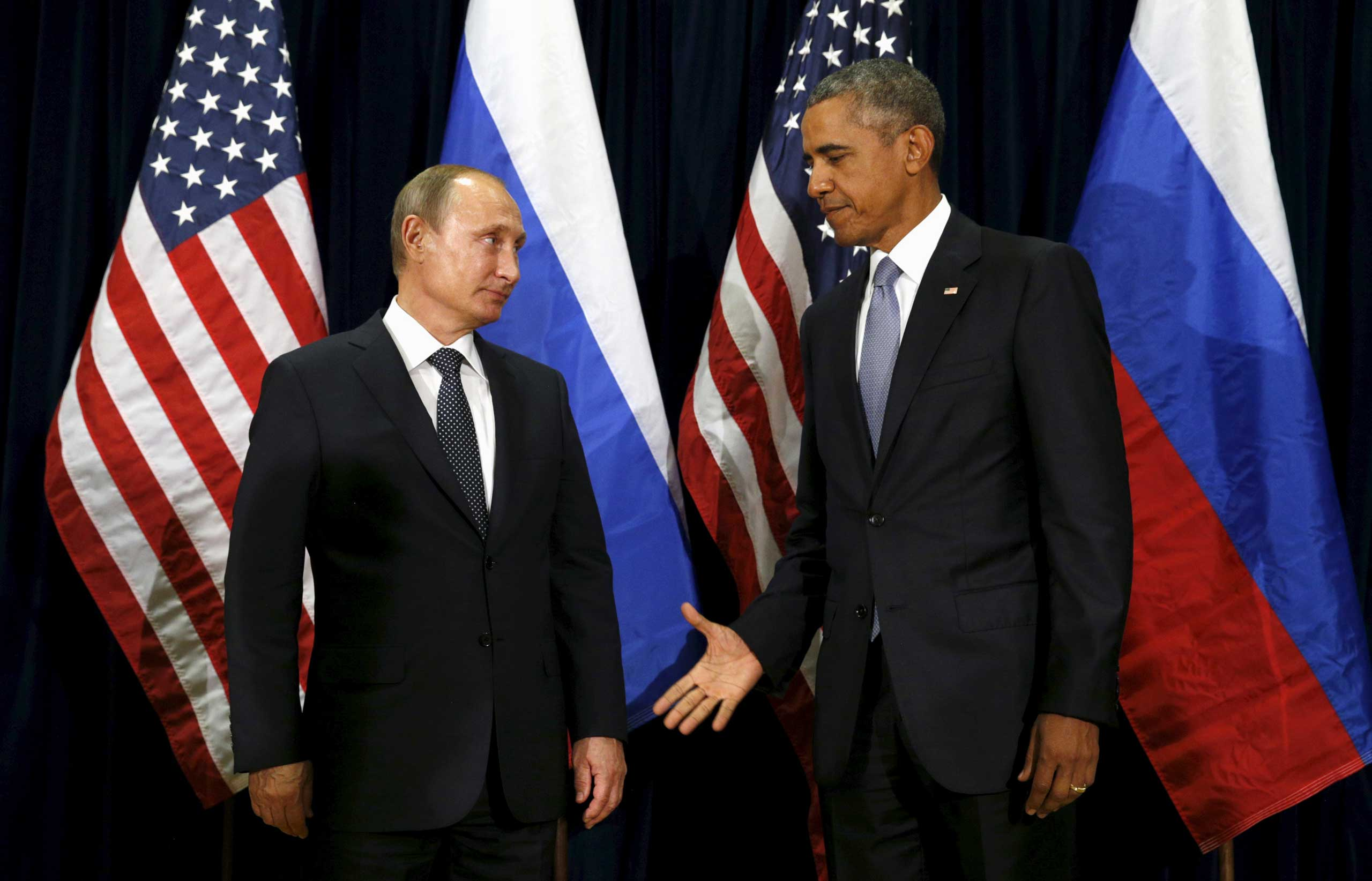 U.S. President Barack Obama extends his hand to Russian President Vladimir Putin during their meeting at the United Nations General Assembly in New York, N.Y. Sept. 28, 2015.