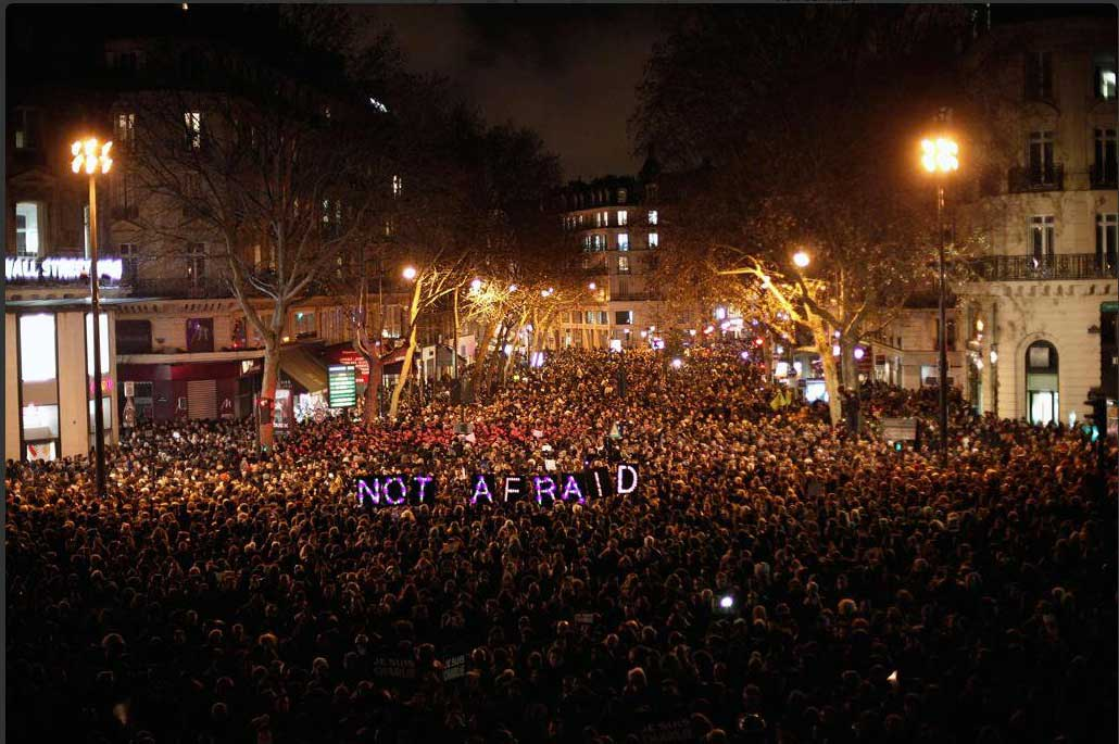People gather to pay respect for the victims of a terror attack against satirical weekly magazine, Charlie Hebdo in Paris. Jan. 7, 2015.