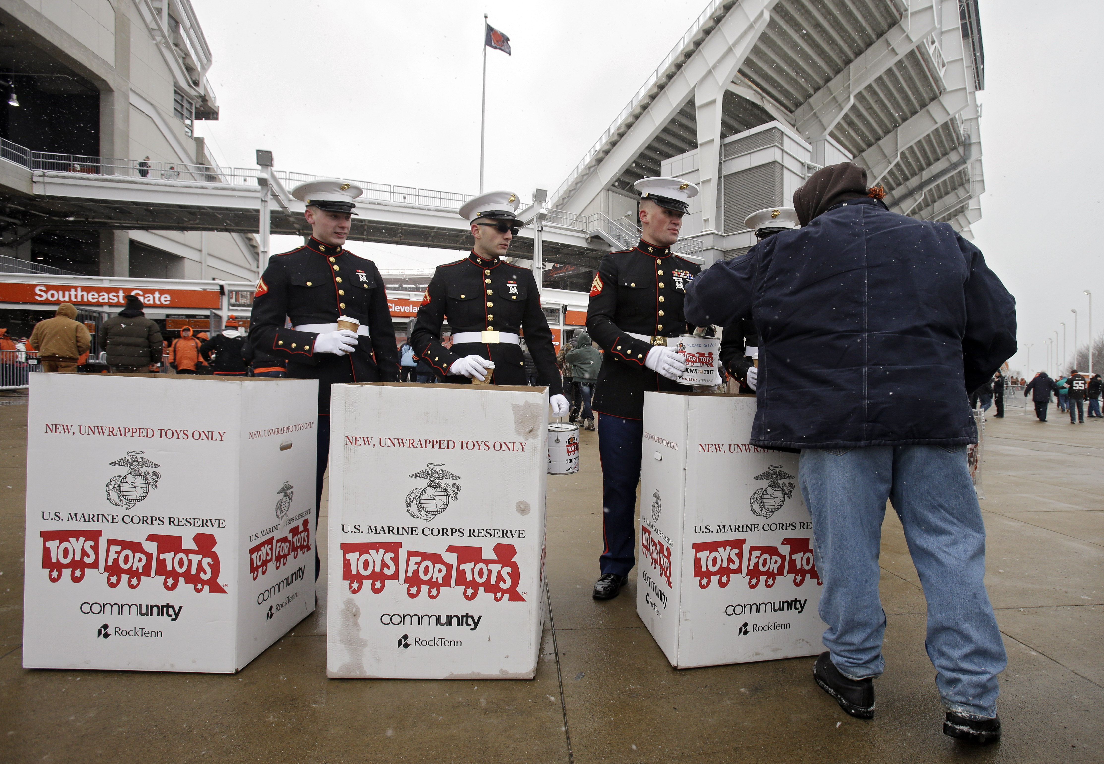 Marines collect toys and donations for the Toys for Tots campaign outside FirstEnergy Stadium before an NFL football game in Cleveland, Ohio on Dec. 15, 2013.