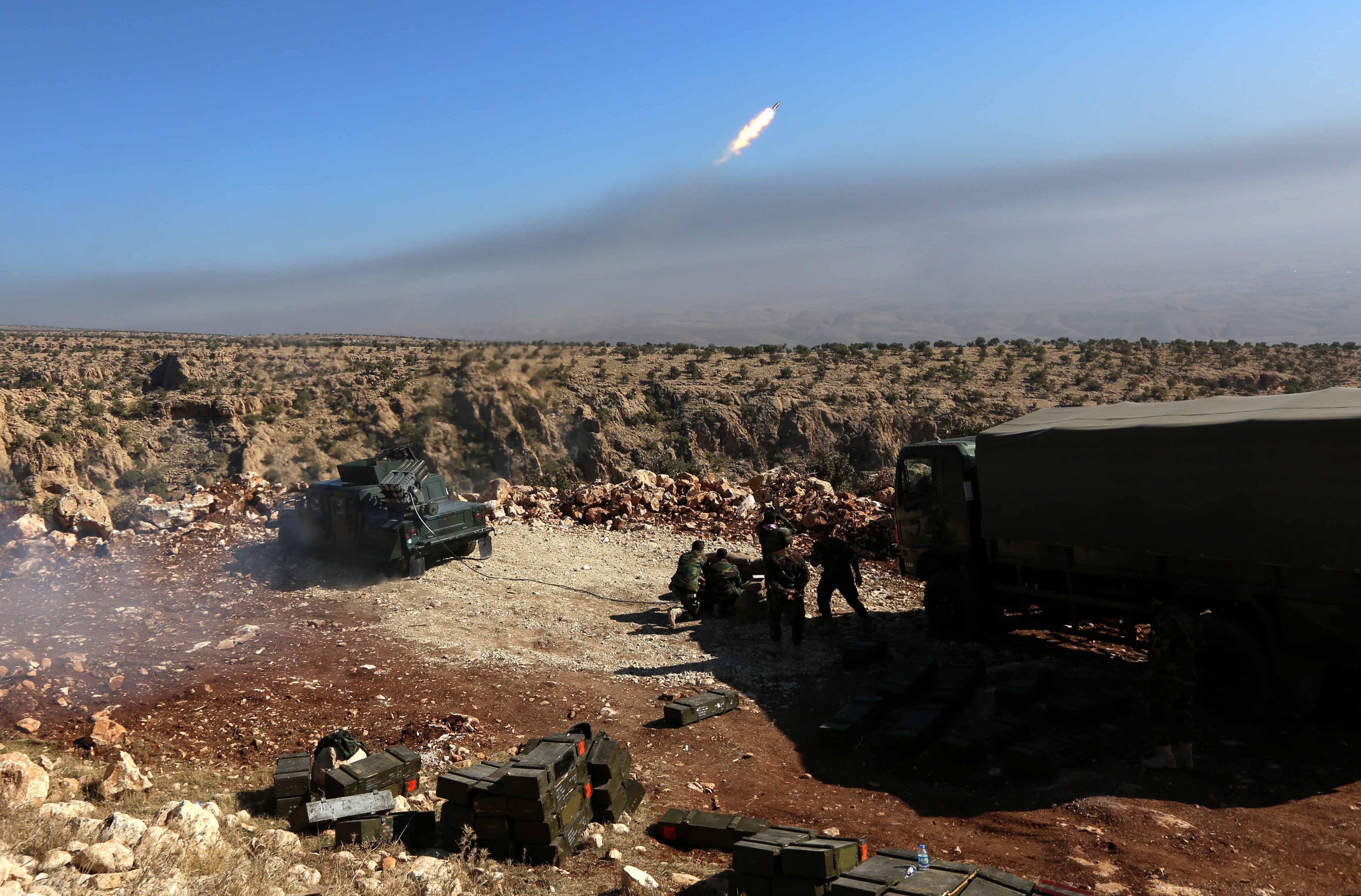 Iraqi Kurdish forces take part in an operation backed by US-led strikes to retake Sinjar, on Nov. 12, 2015.